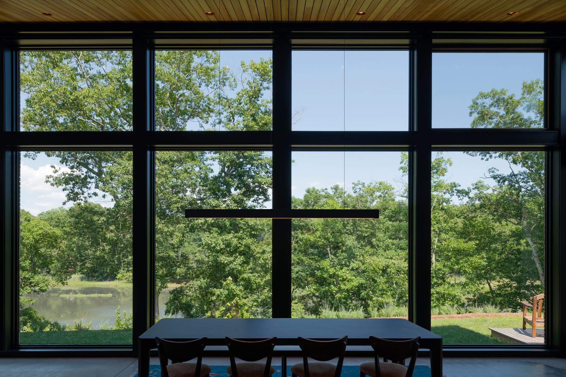 Floor to ceiling windows provide views of the marshland.