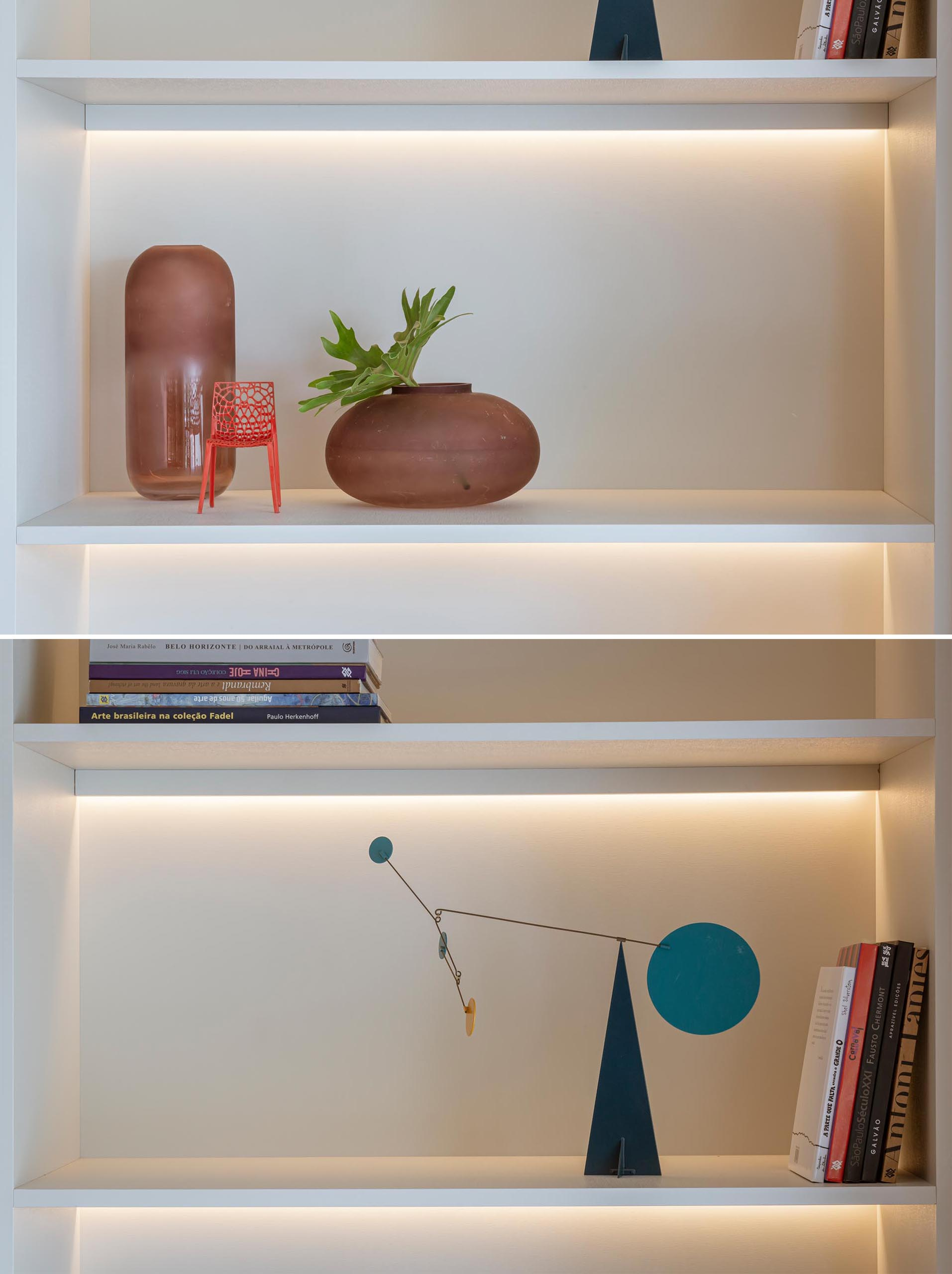 A floor-to-ceiling white shelving unit that includes hidden LED lighting.