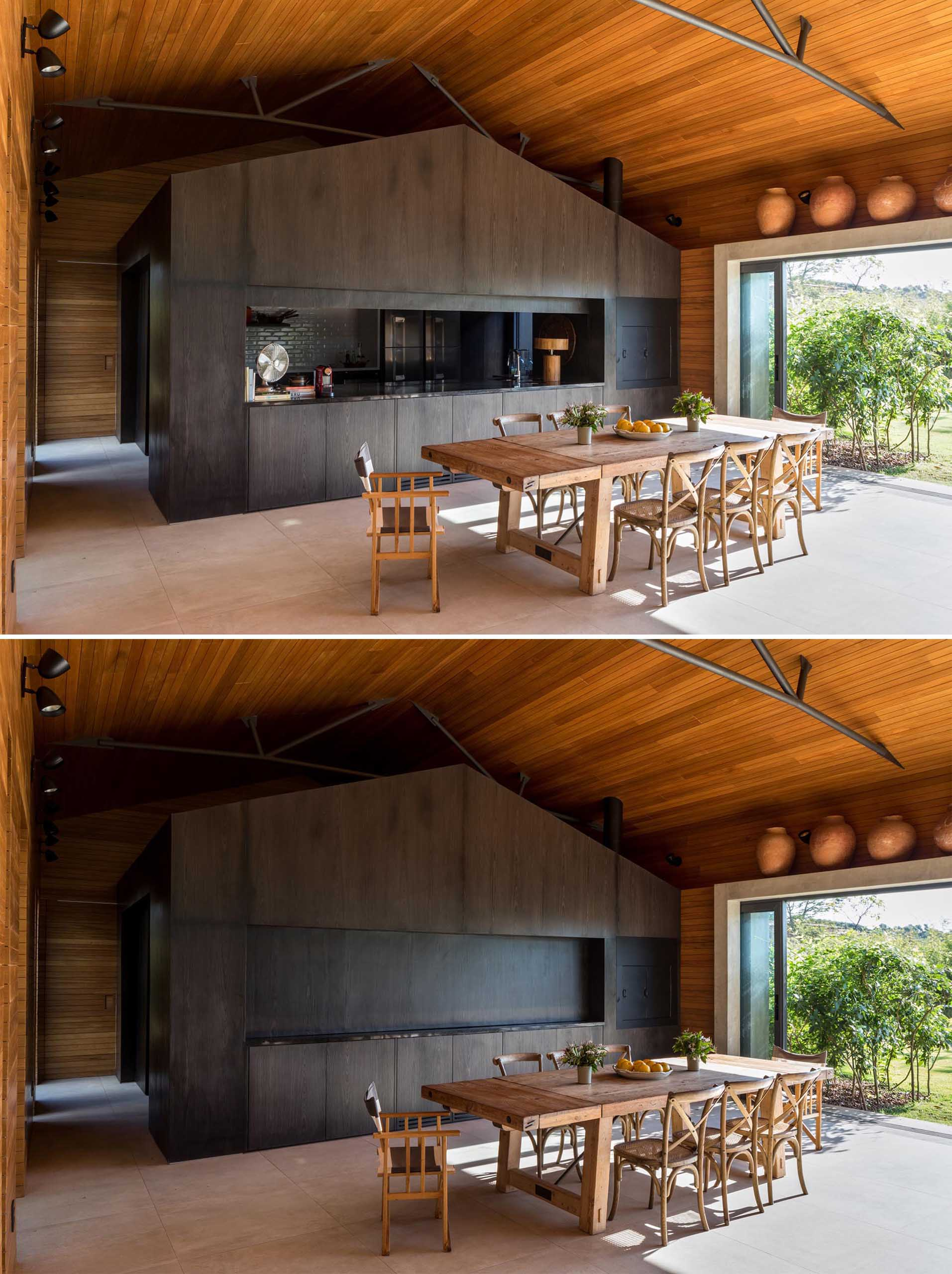 The interior of this modern home is lined in Tauari, a Brazilian pale wood, while the kitchen is completely made out of darkened wood. The kitchen can also be hidden from view, as a section of the cabinetry can be lowered down to close it off.