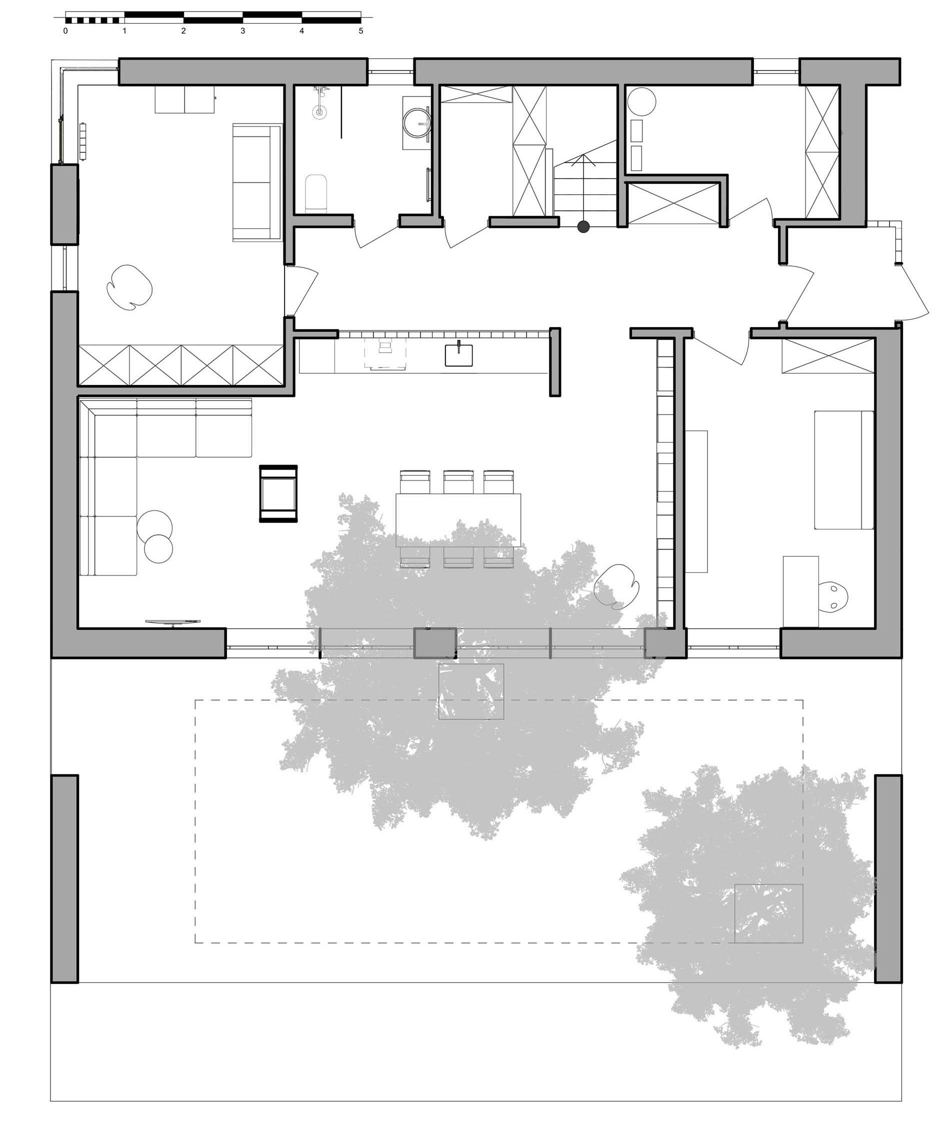 The floor plan of a modern house with a sloped green roof.