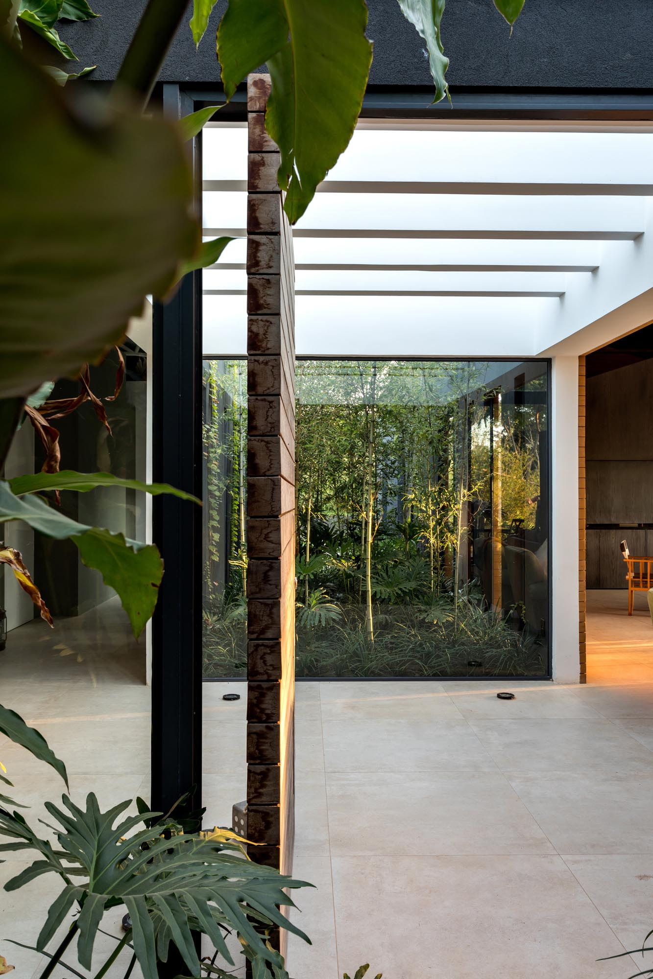 This modern home entryway provides a separation between the social areas of the home, and the bedrooms / bathrooms.
