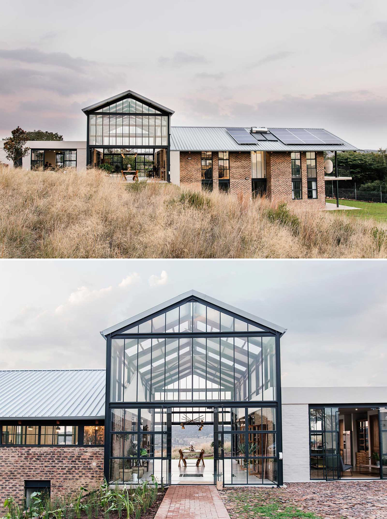 The double-height conservatory can be opened, providing uninterrupted views of the landscape, while a glass section flooring gives a glimpse of the lower level below.