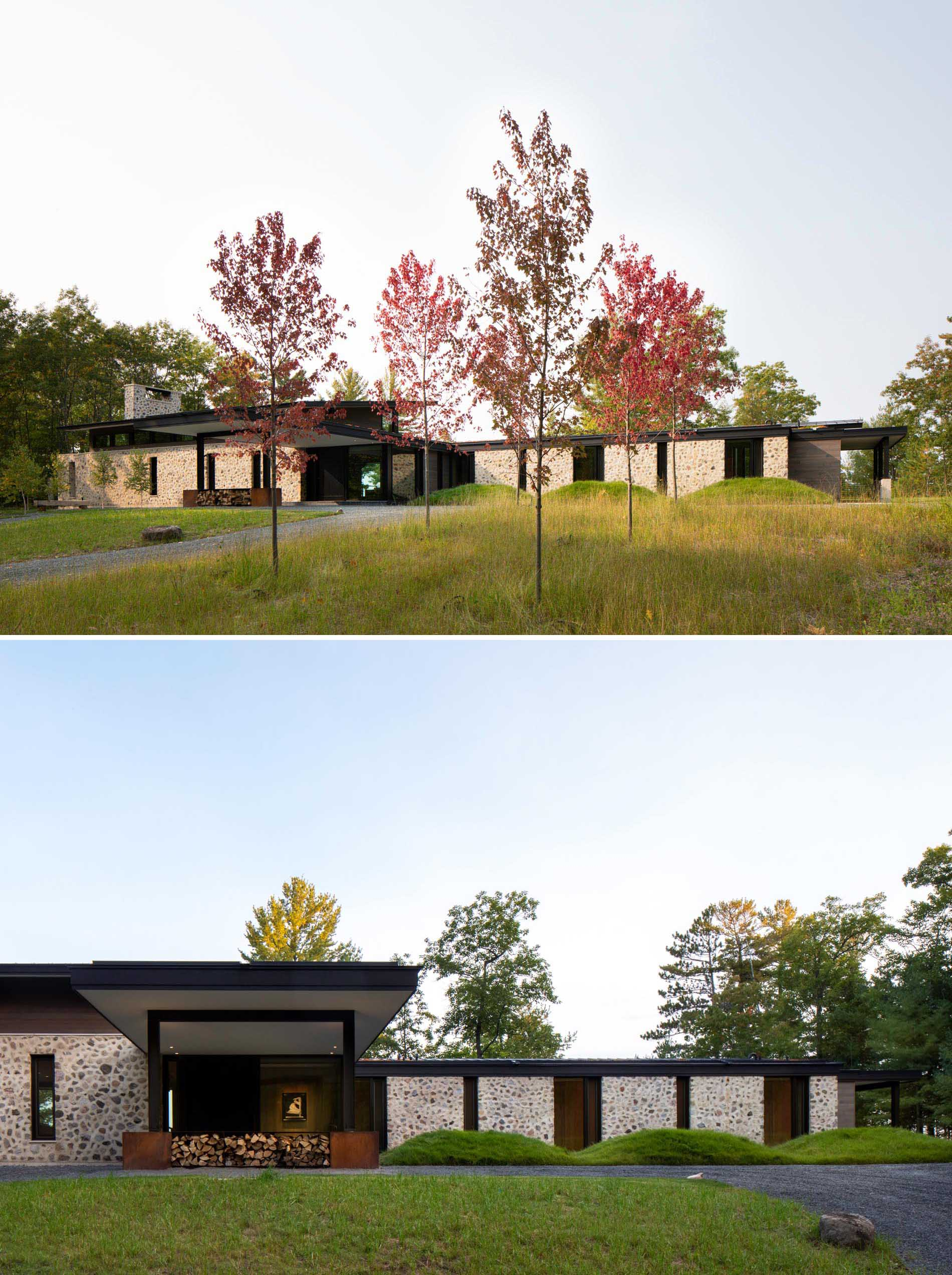 Rough-cut fieldstone set in thick, hand-troweled mortar stretches across this modern homes exterior's south facade and connects with the interior two-story central fireplace.