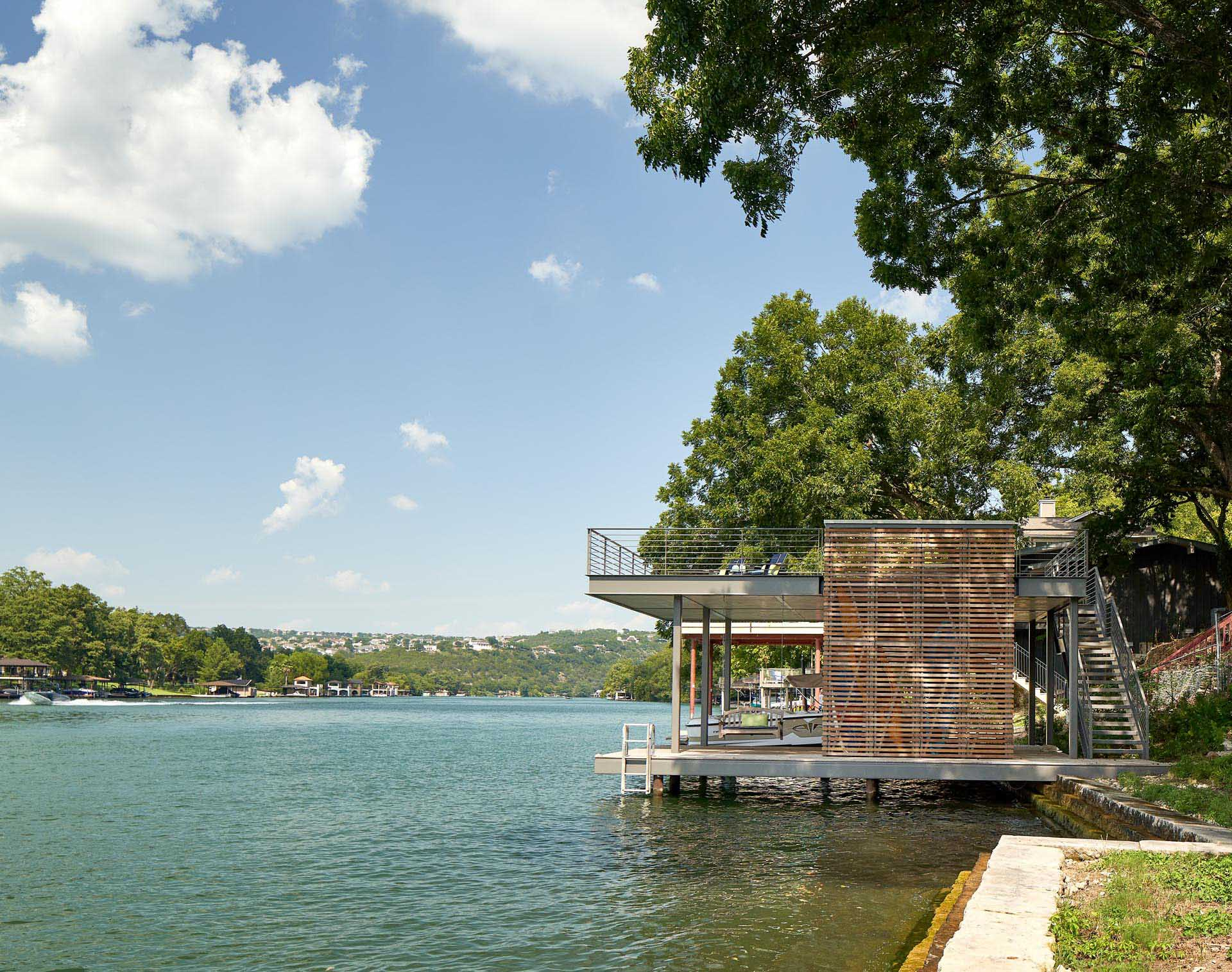 A two level boat dock provides an outdoor lounge space perched above the water.