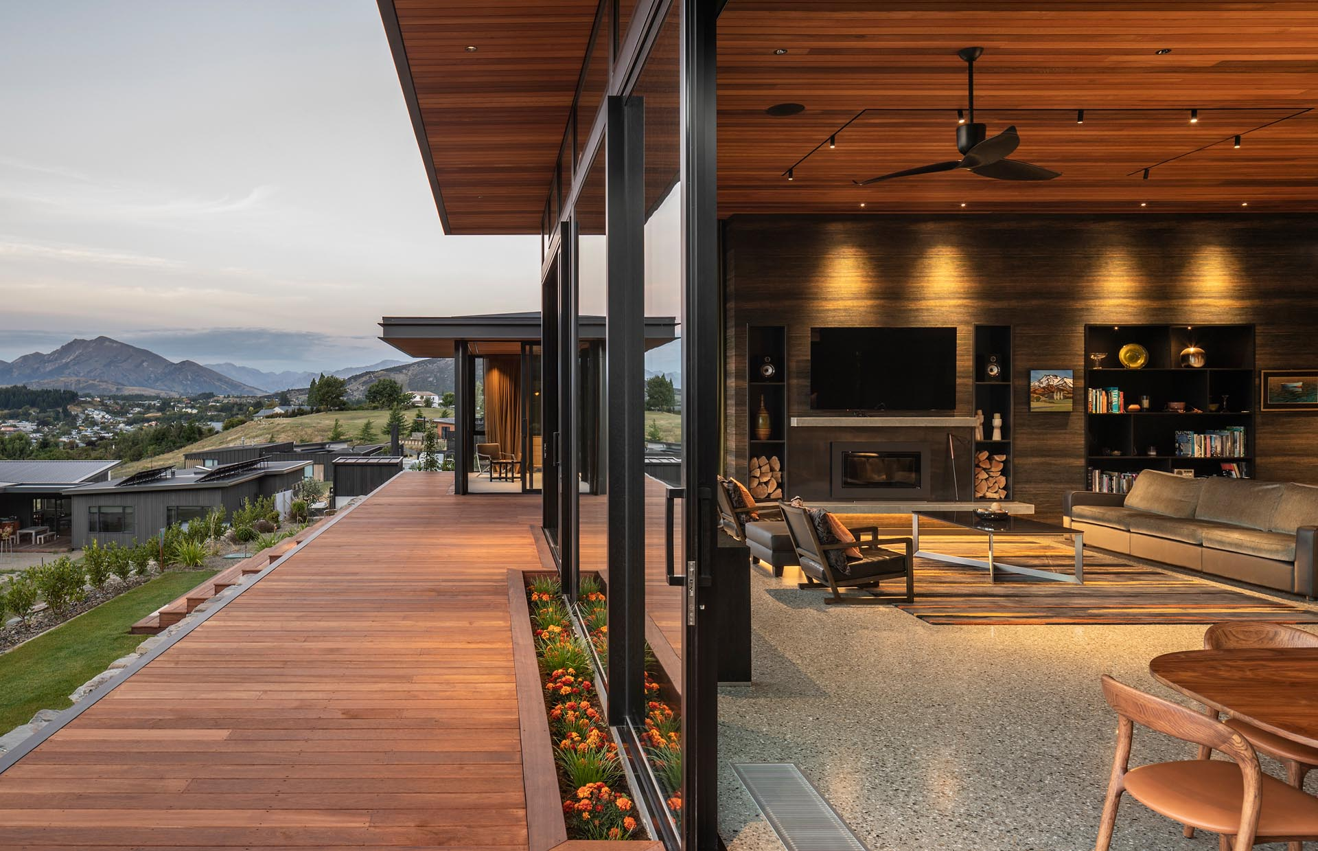 A deck with steps that lead down to the yard also connect with the interior spaces as well as a courtyard.