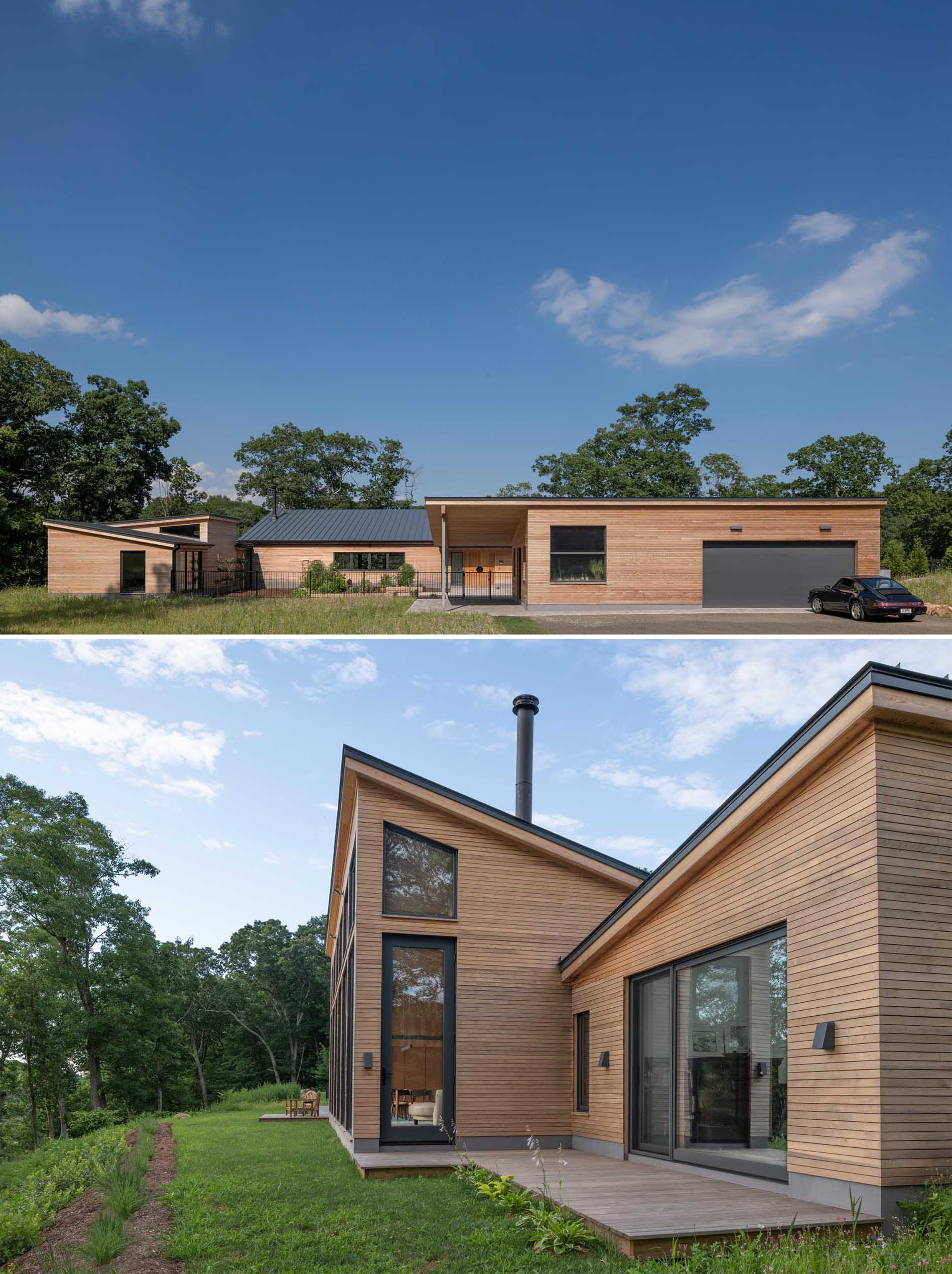 A modern house with wood siding and charcoal colored accents, like window frames, metal roof, and garage door.