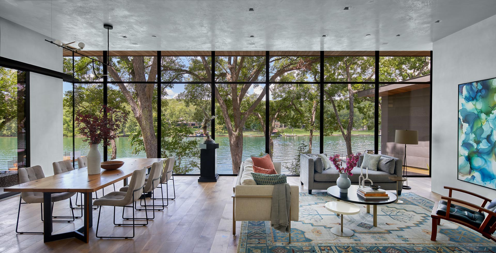 The new living room and dining area, which is open to an outdoor space, has a wall of floor-to-ceiling windows, while the open plan nature of the room allows the natural light and views to be enjoyed from any location.