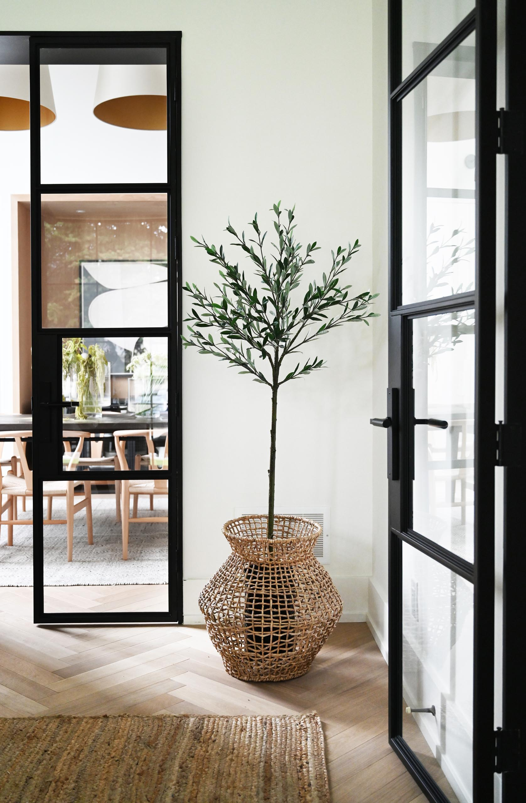 Connecting various areas of the interior are black-framed glass doors that provide a glimpse of the other rooms.