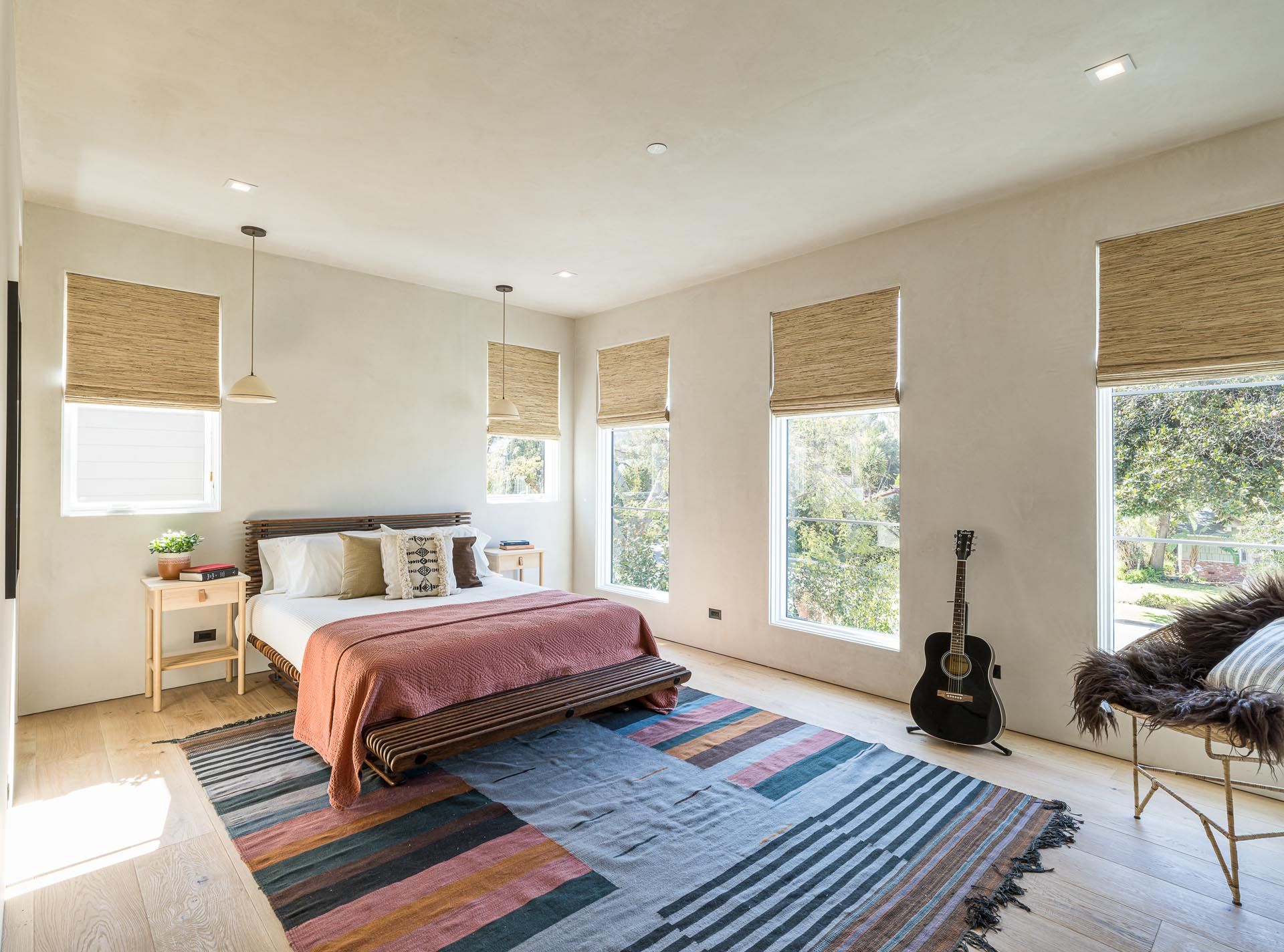 A contemporary guest bedroom with white oak floors.
