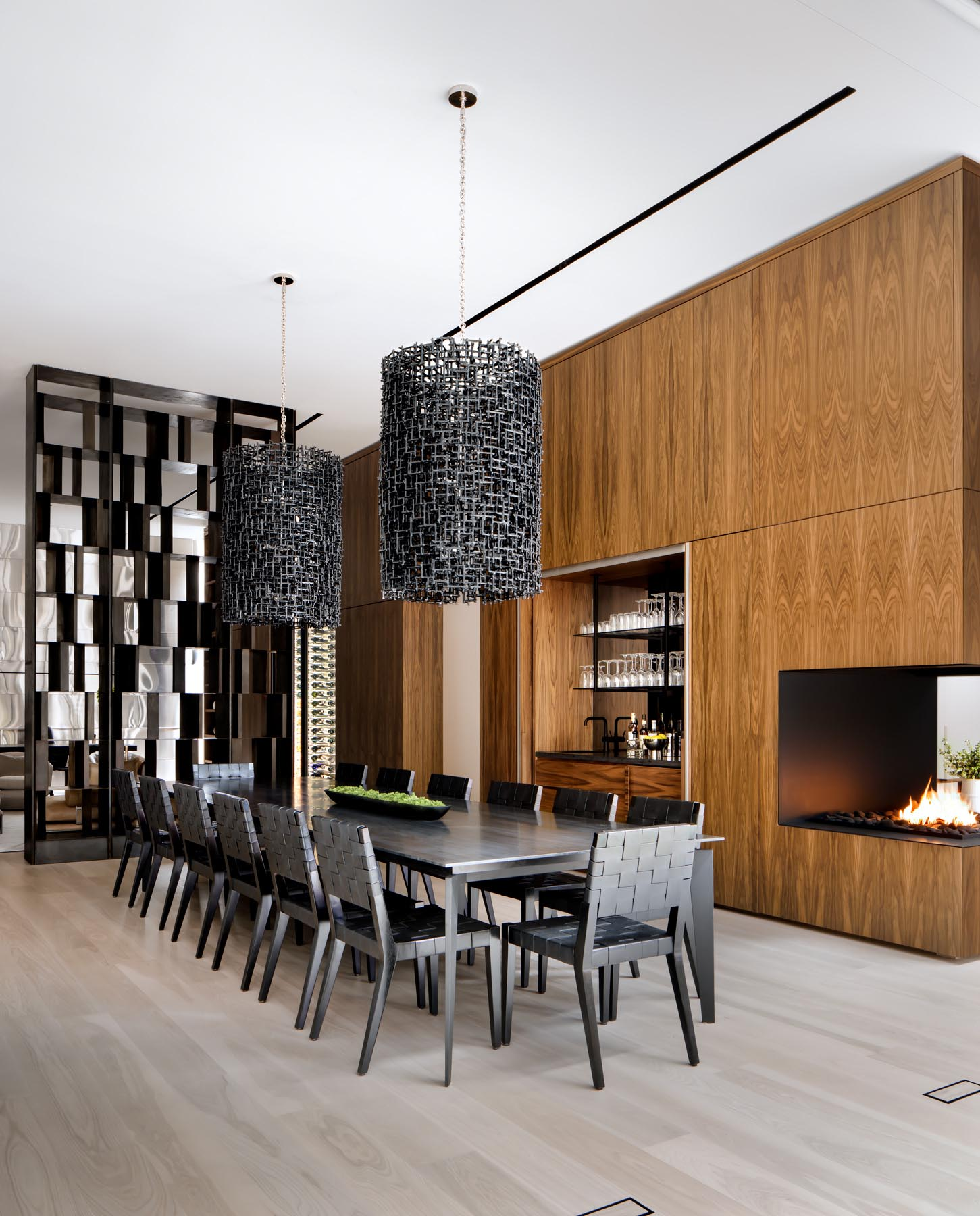 A large shelving unit separates the dining room from the Scotch lounge, while a set of bi-fold doors open to reveal a wet bar.