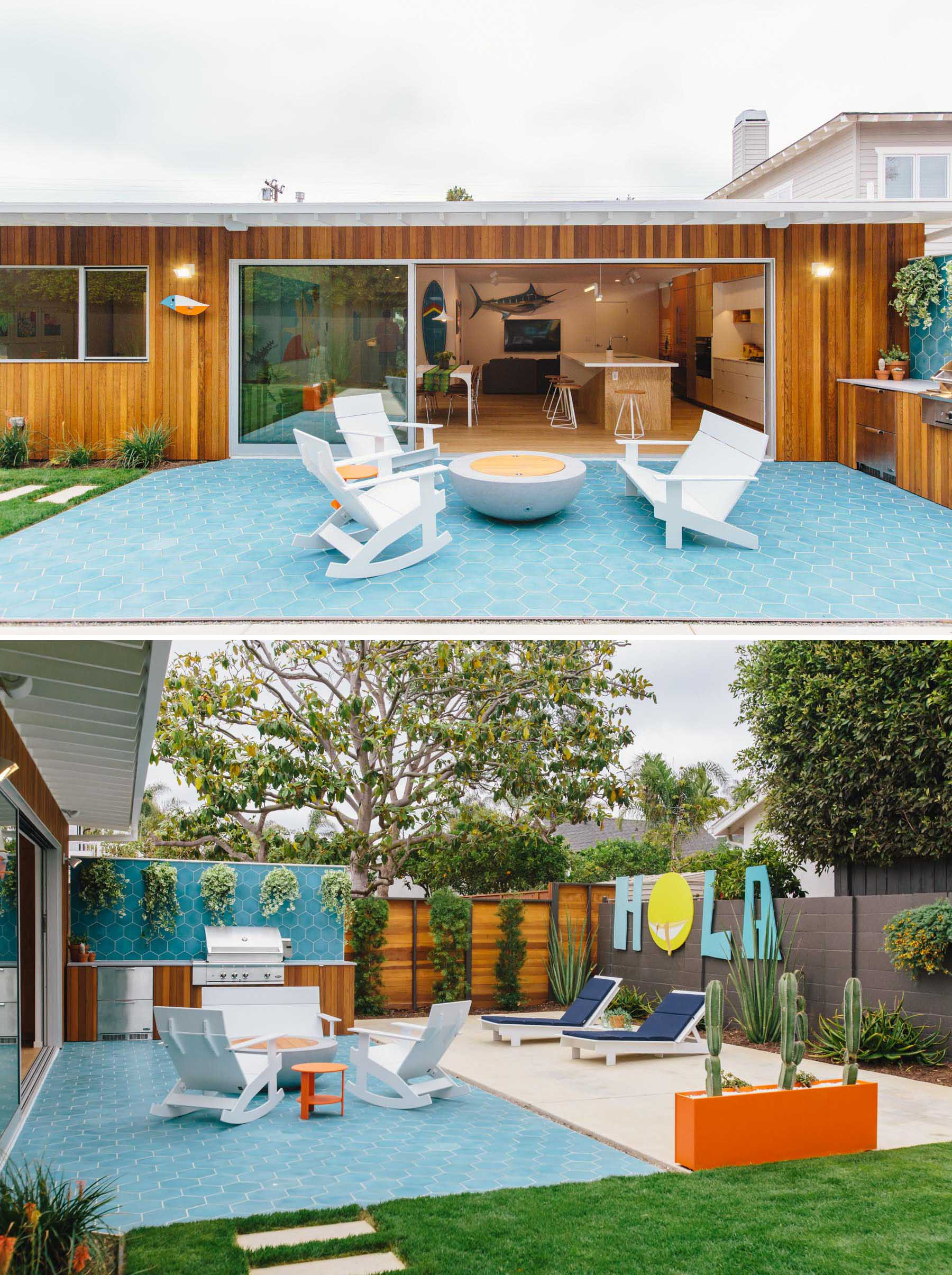 The new outdoor space includes an outdoor kitchen with built-in BBQ, a blue hexagonal tile patio, a fire bowl with lounge chairs, a colorful planter and artwork, and a grassy yard. Due to California state drought conditions, landscaping mandated low mow/drought tolerant grass, succulents, and cacti.