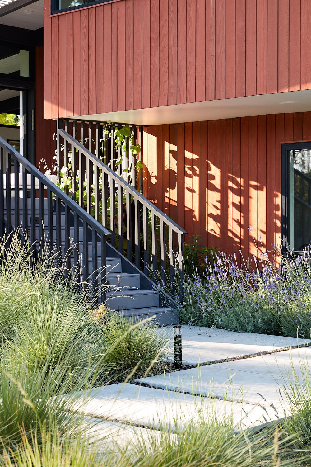 Contemporary remodel included refinishing the wood siding, and updating the stairs and pathway.