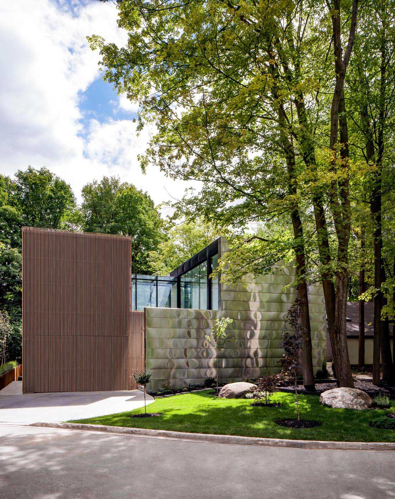The design of this modern house includes a solid front facade, with a tucked away entryway, that afforded the client the privacy they desired.