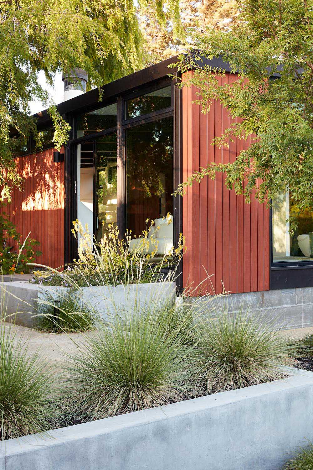 A remodeled mid-century modern house with a mix of relaxing outdoor patio spaces that blend into the native landscaping.
