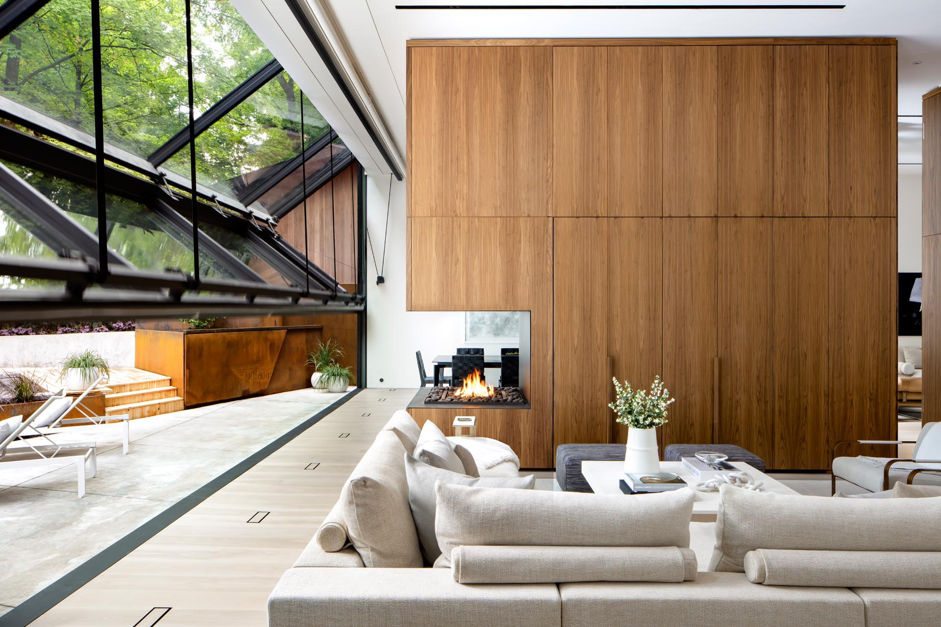Multi-disciplinary atelier Ancerl Studio has designed a modern home in Toronto, Canada, and unique to the house, is a large 40 foot folding glass wall that folds open.