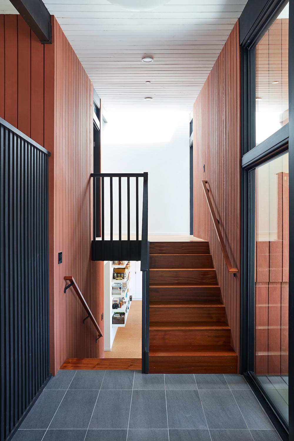 Wood stairs connect the various levels of this remodeled home.