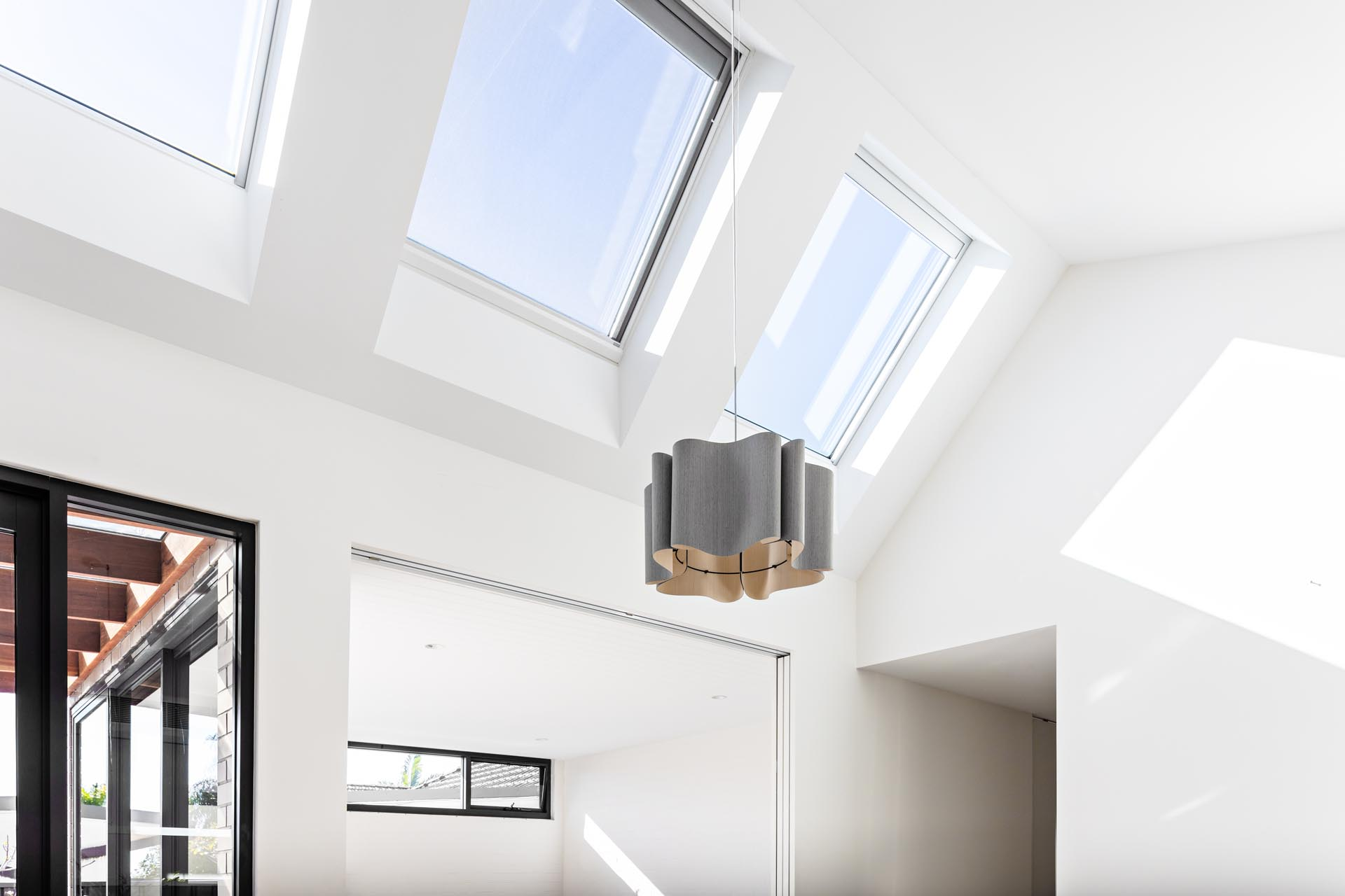 A series of large north orientated skylights flood the addition with daylight that illuminates the natural materials and textures.