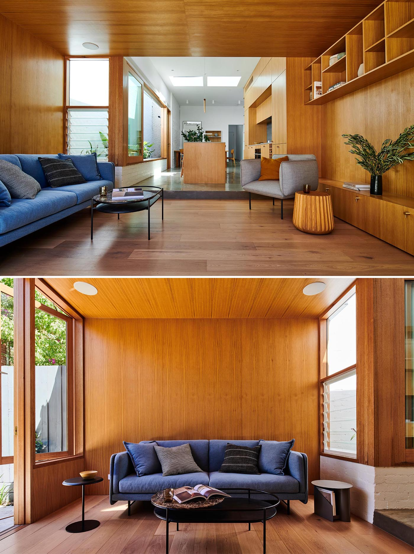 A modern sitting area, which opens to the backyard, includes wood walls, louver windows, shelving, and a colorful blue couch.
