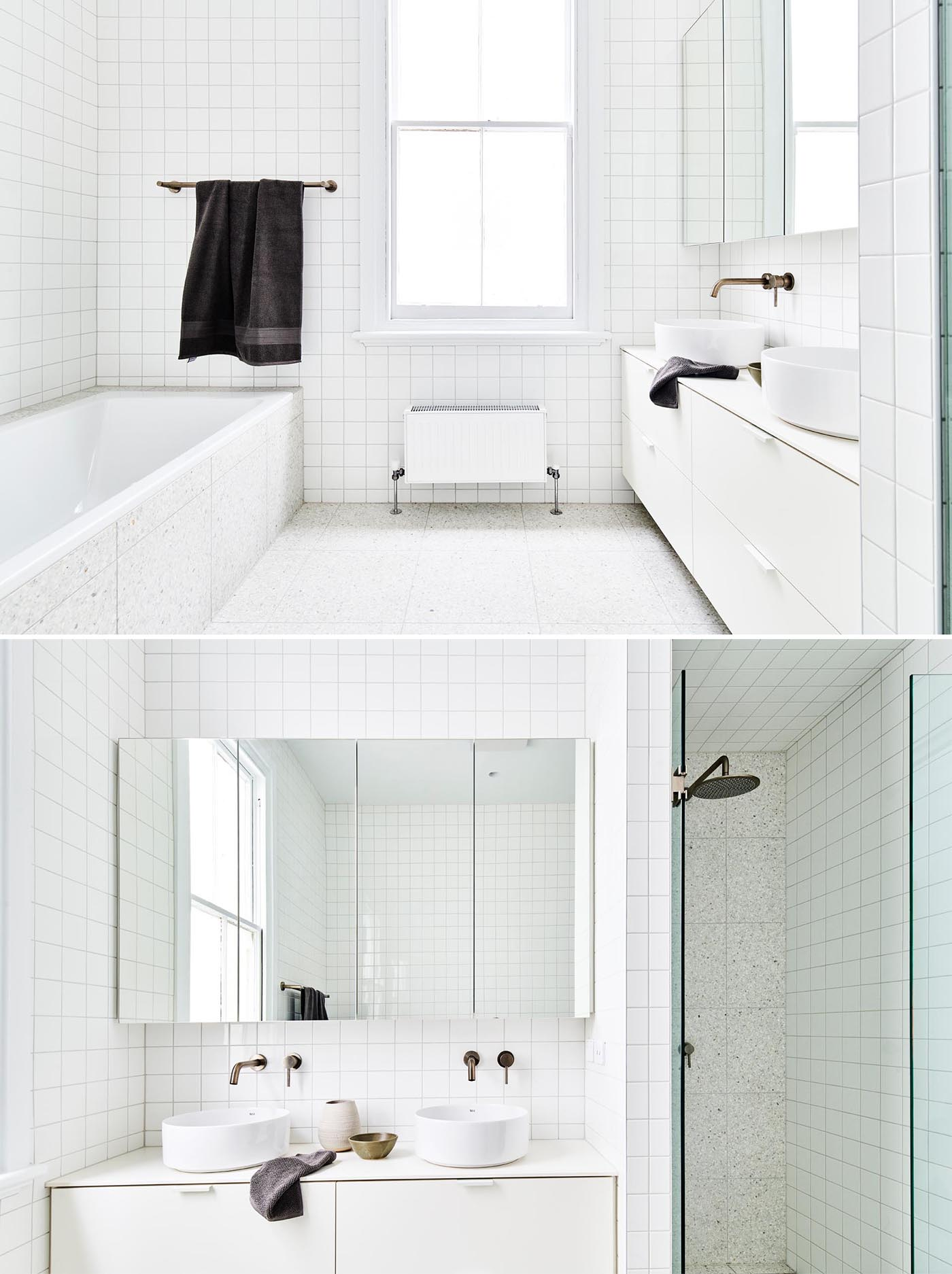 A modern white bathroom with square tiles.