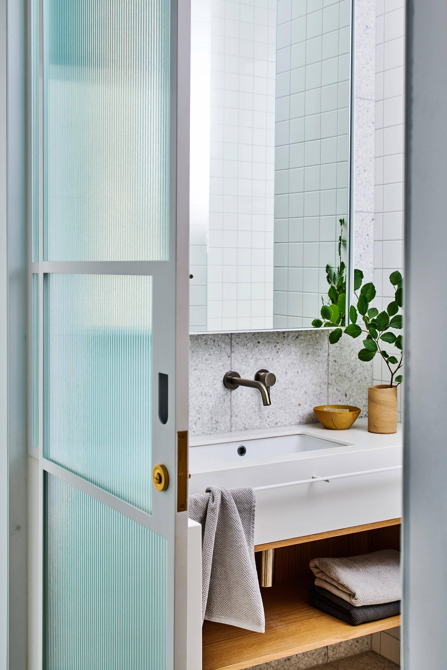 A sliding glass door with texture.