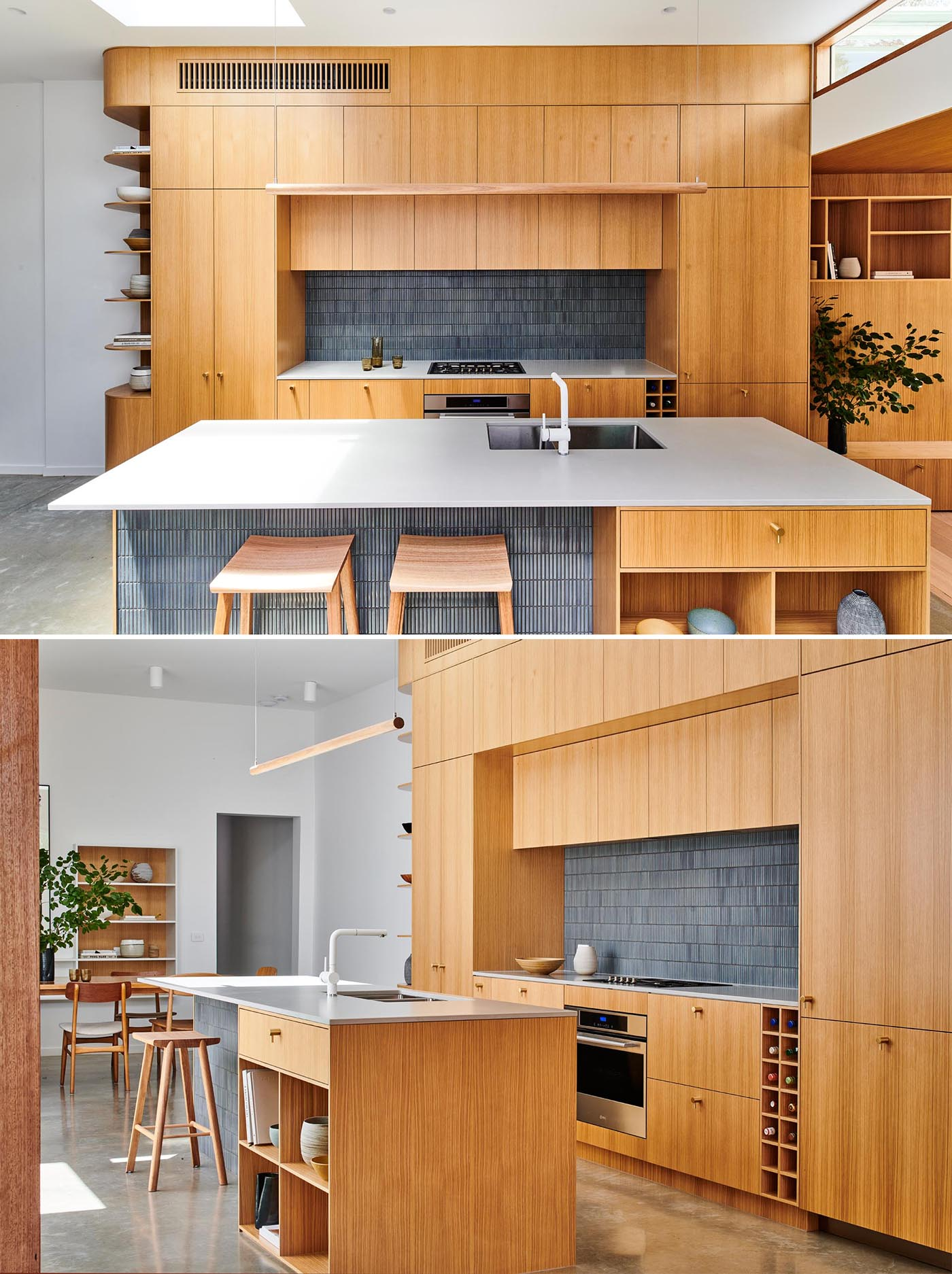 A modern wood kitchen with gray tiles, an island, open shelving, white countertop, and built-in wine storage.