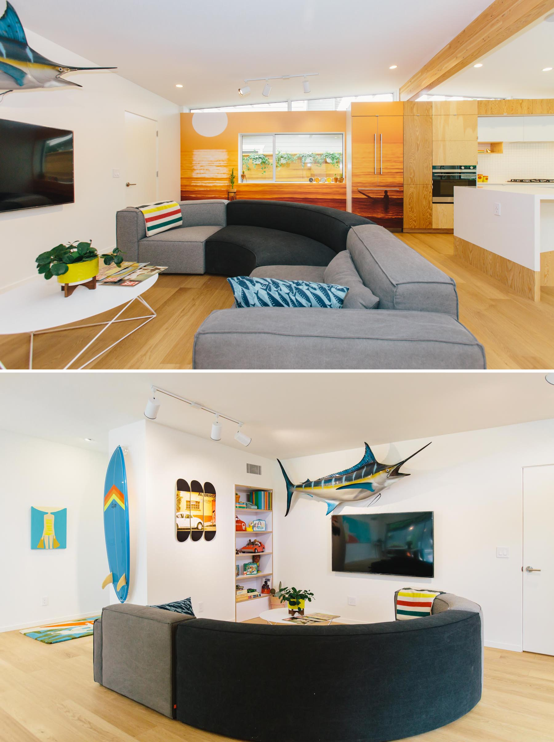 This updated living room is defined by a curved couch, built-in shelving, and a beach-inspired mural.