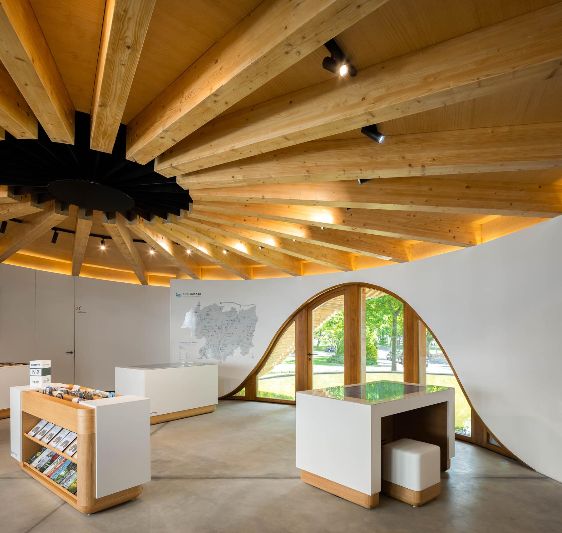 Inside this round building, there's a single open-space room with an exposed wood ceiling,
