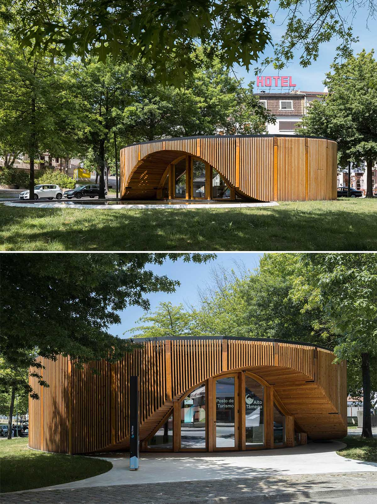 A small modern building has a circular design that's built using a structural base of timber pillars and beams over a concrete slab.