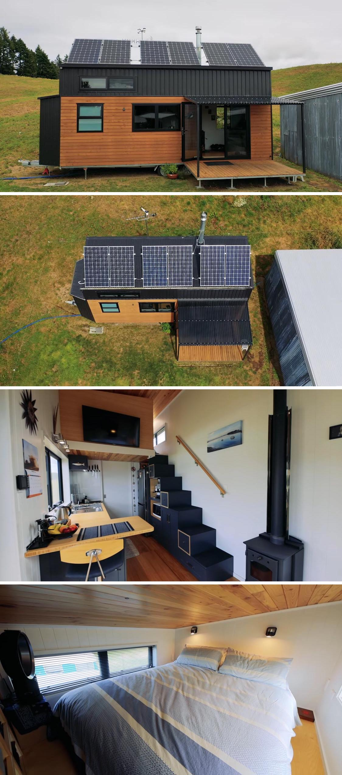 This handcrafted tiny house in New Zealand, has been designed to be off-the-grid, with solar panels and a rainwater collection system. There's also black metal and wood siding with a small covered deck, and a modern interior with lofted bedroom.