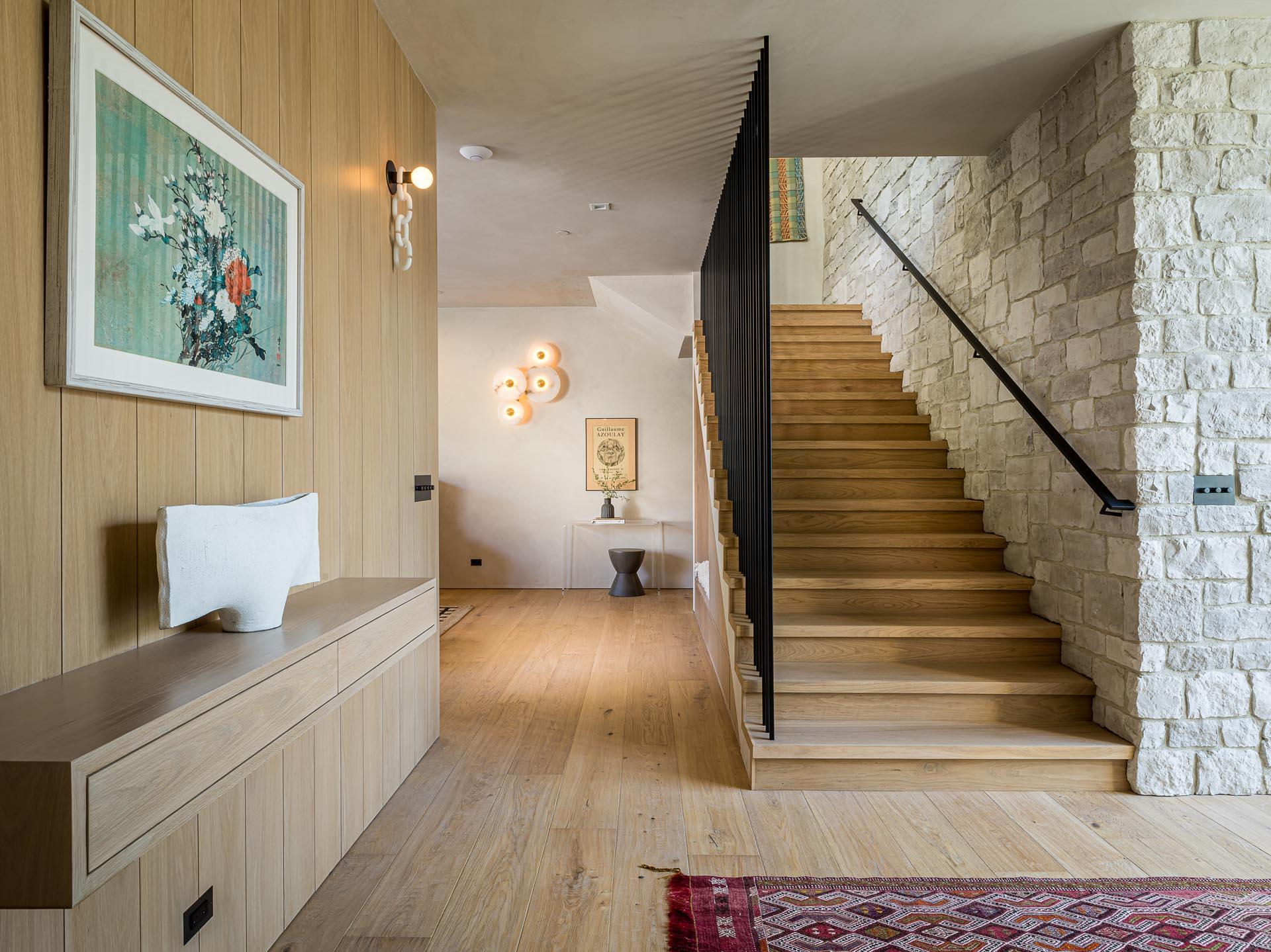 A modern entryway with wide plank white European ¾ oak floors.