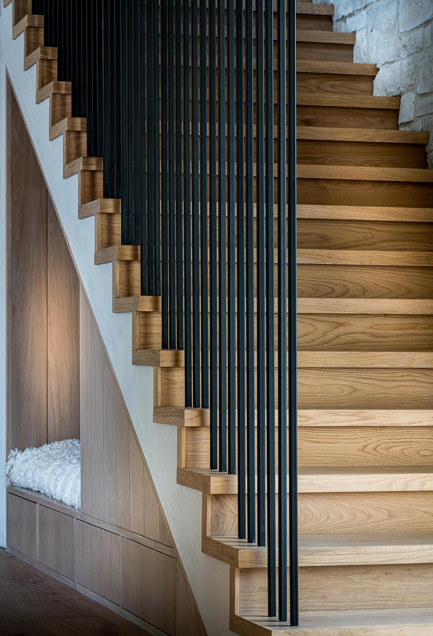 From this angle, which also shows the design of the stairs, you can see how neatly the seating nook and storage is tucked away into the available space.
