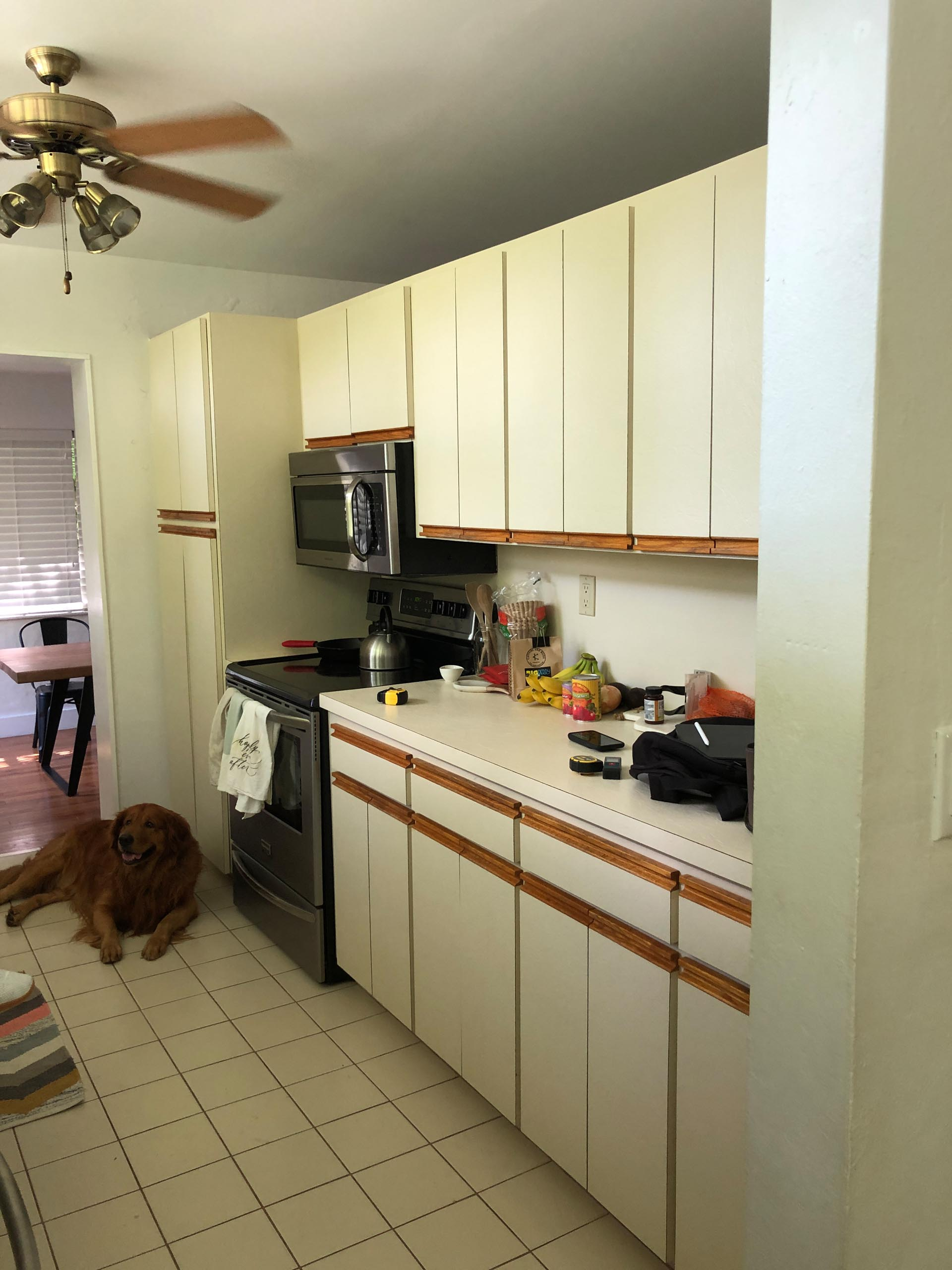 BEFORE - An enclosed and dated kitchen.