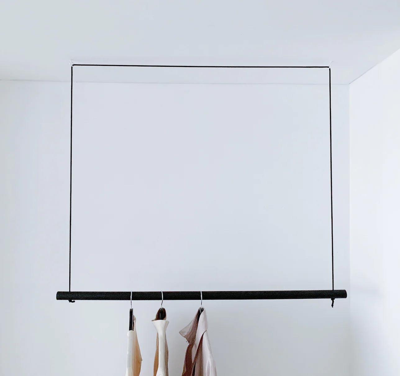 Storage Idea - Modern hanging black clothes rack.