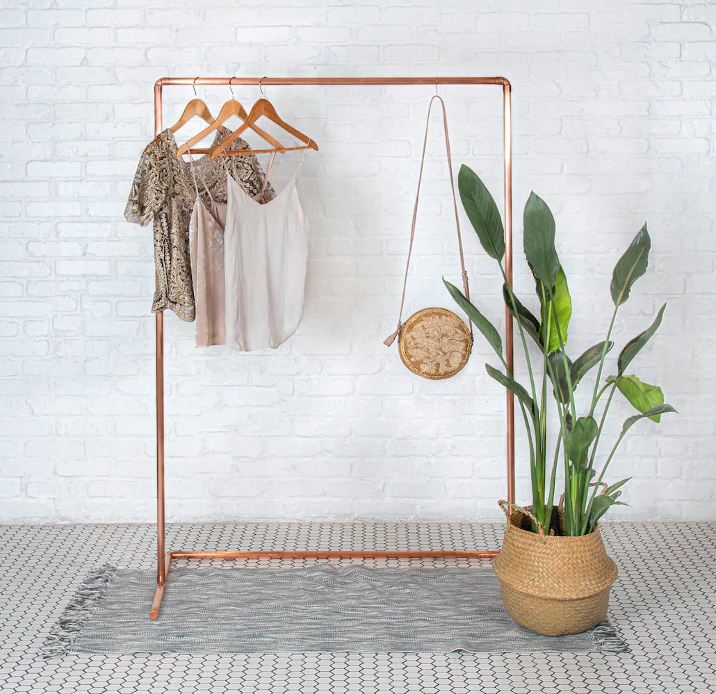 Storage Idea - Modern freestanding copper clothes rack.