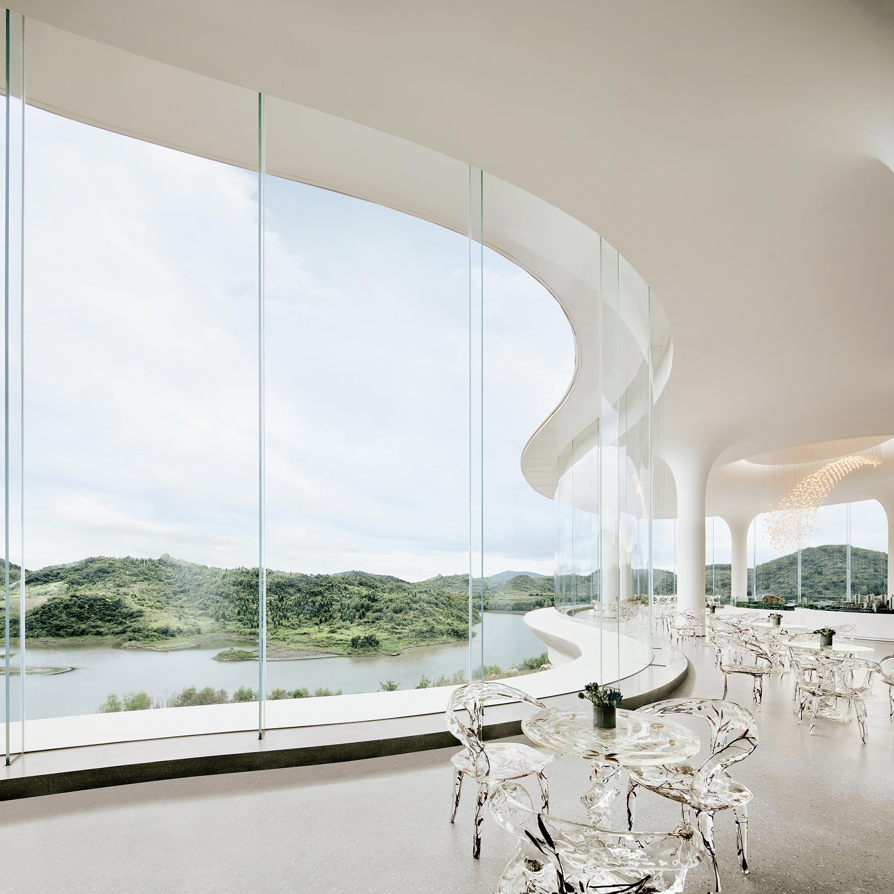 A modern sales center with tall curved glass walls.