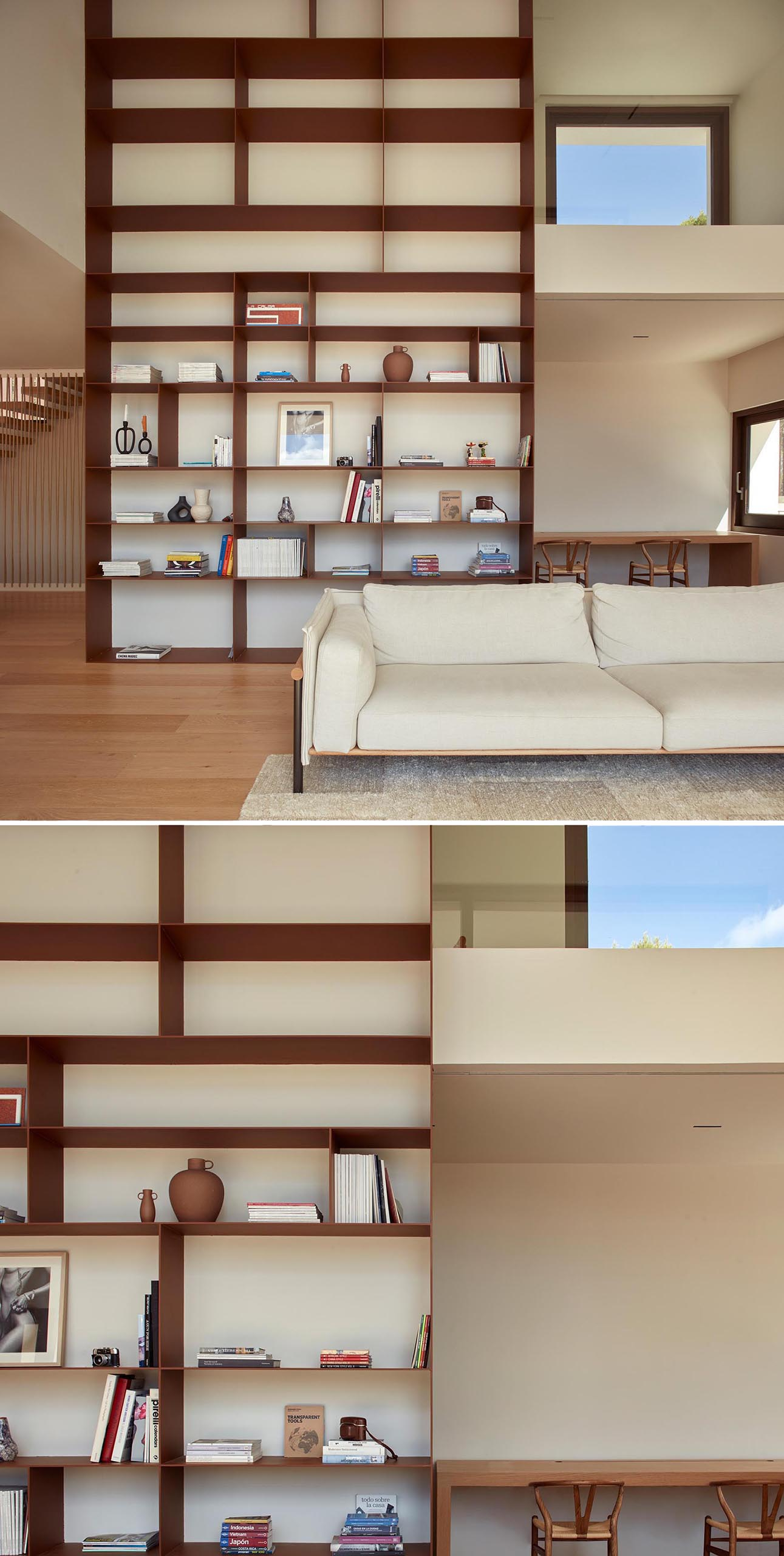 A modern living room with a double-height bookshelf.