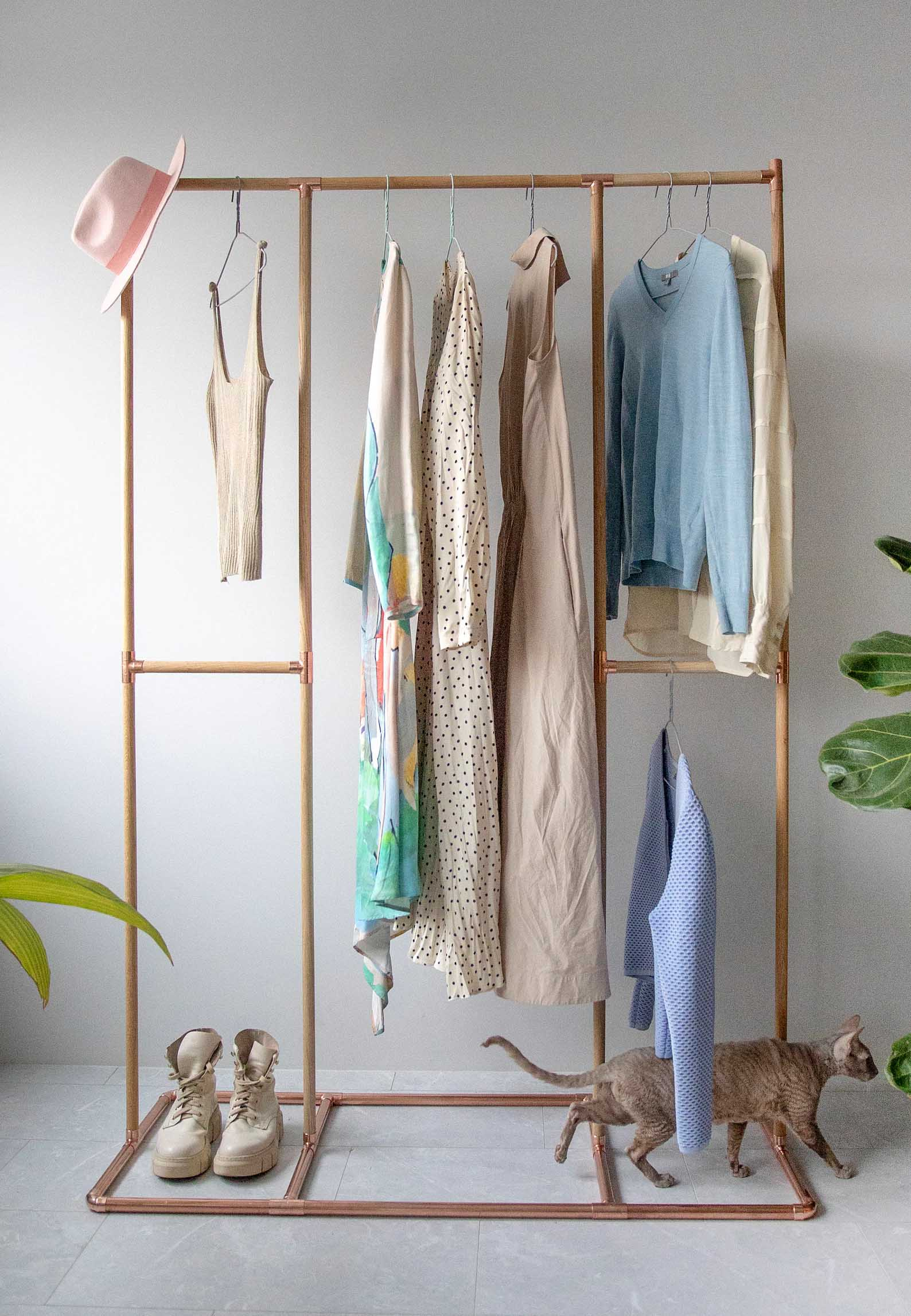 Storage Idea - Modern freestanding wood and copper clothes rack.