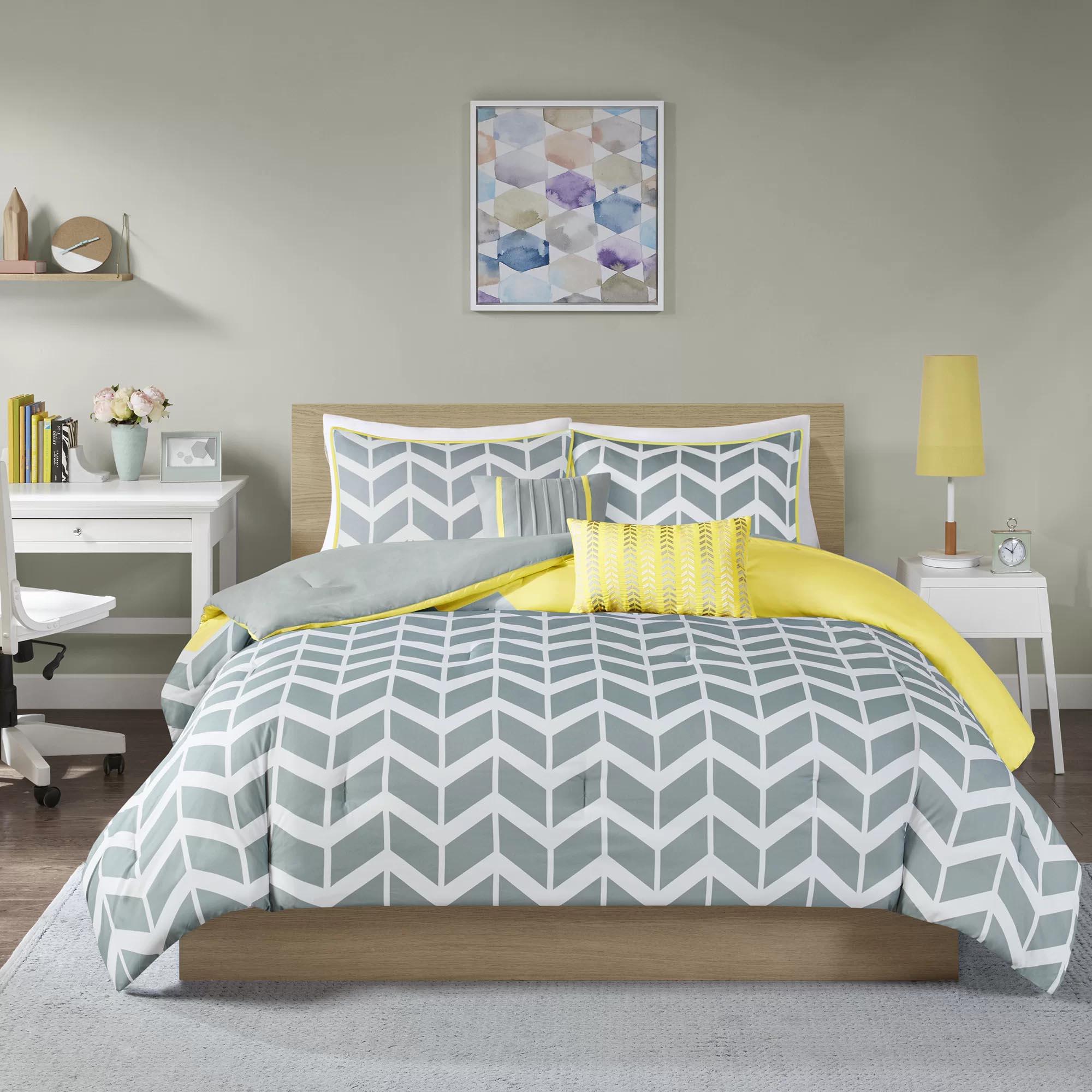 Modern Bedroom Decor - Grey, white, and yellow geometric bedding.