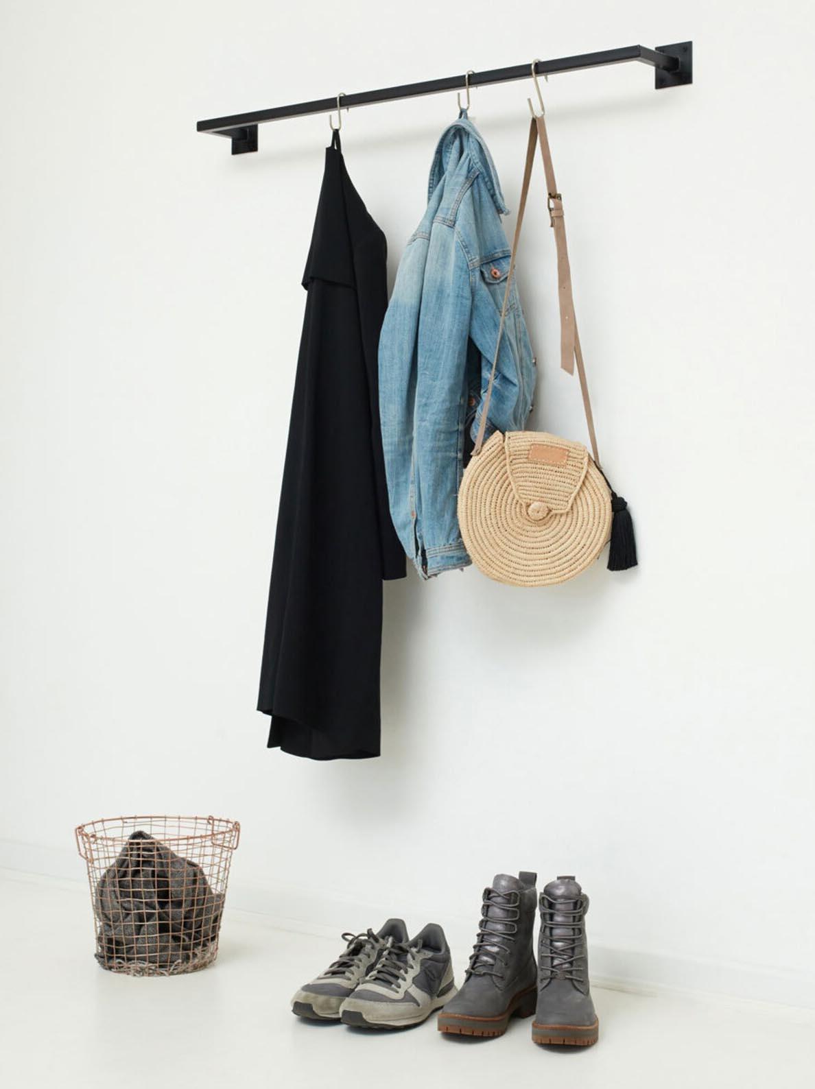 Storage Idea - Modern wall mounted black clothes rack.