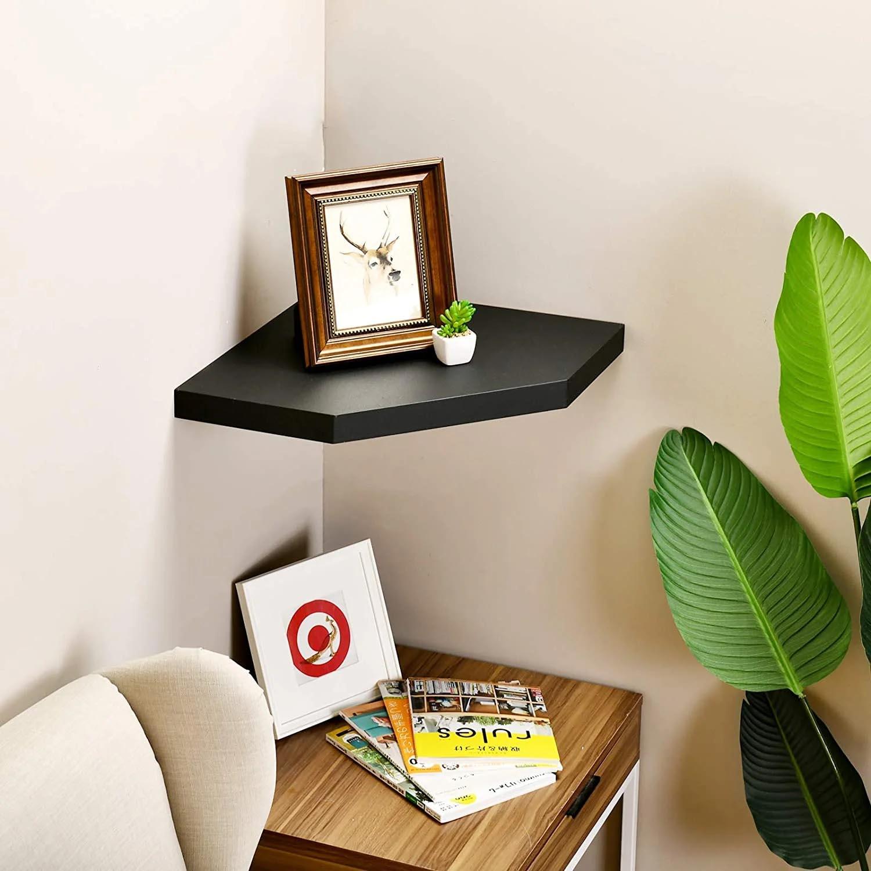 Corner Shelf Ideas - A minimalist floating black corner shelf.
