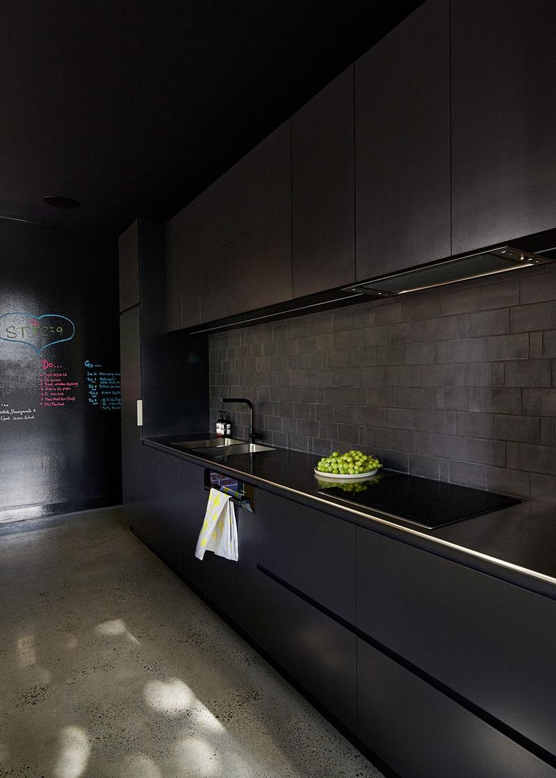 MAKE Architecture have designed a home in Melbourne, Australia, with a minimalist black kitchen.