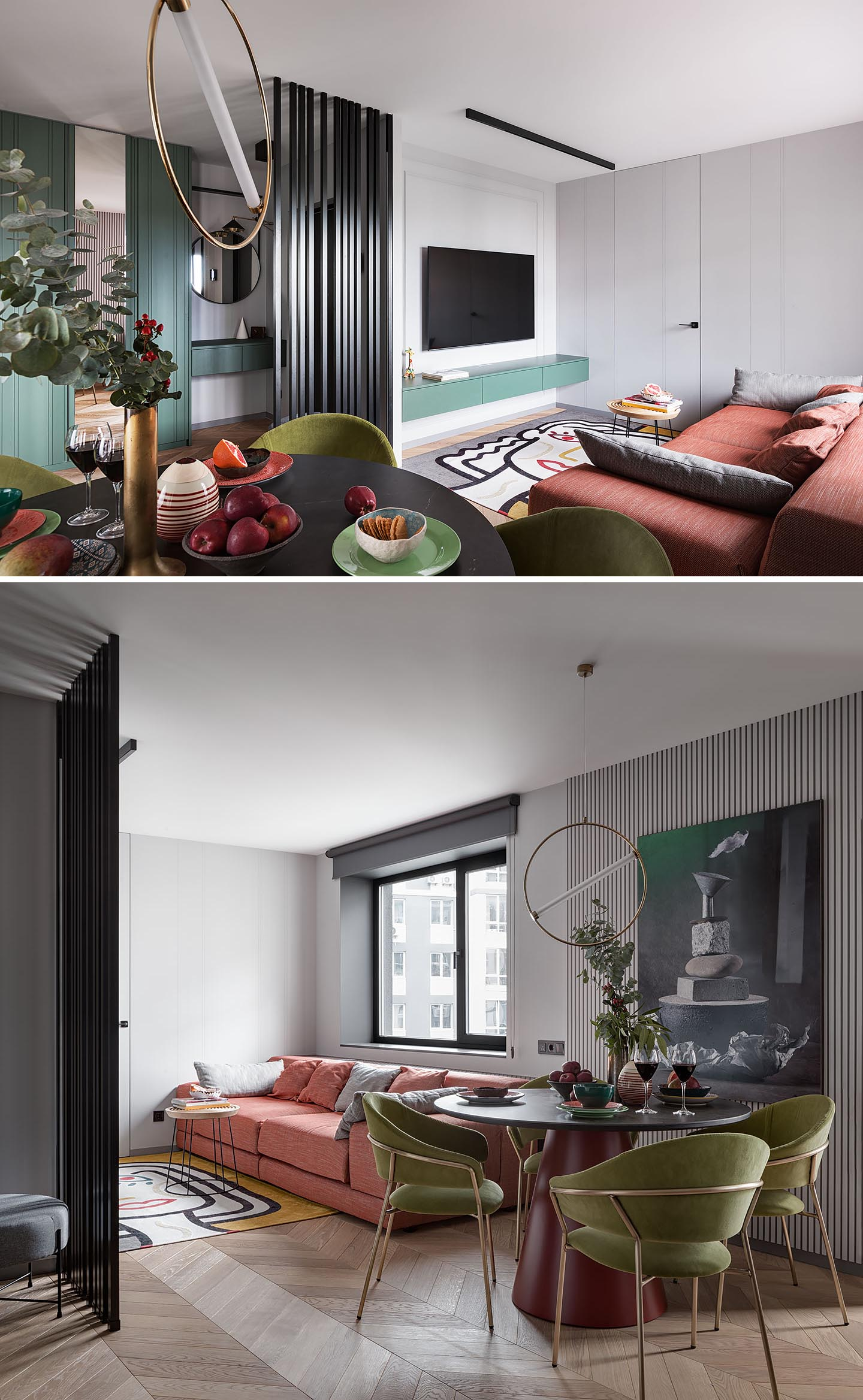 In the living room, a black vertical slat partition creates a separation between the entryway and the living space, where there's a large and colorful couch that faces the television.