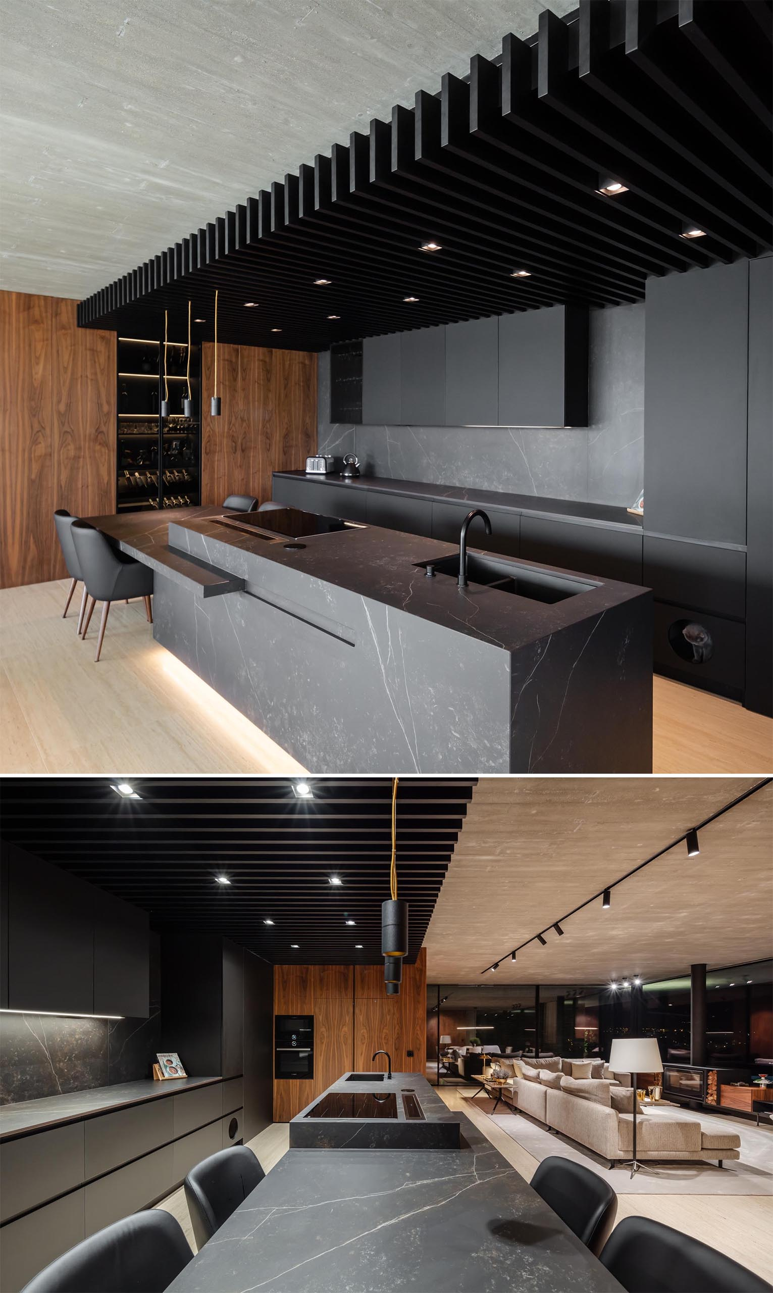 TRAMA arquitetos designed a modern concrete home in Braga, Portugal, that includes a black kitchen.