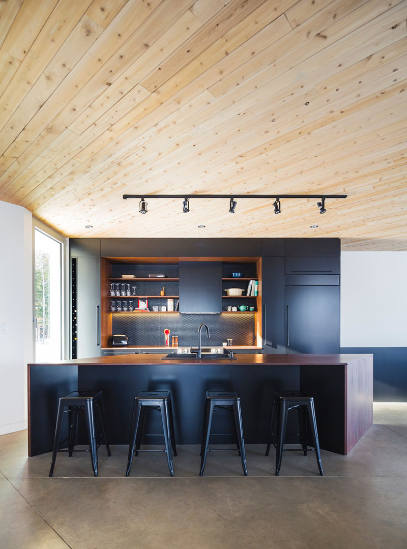 Designed by MU Architecture, this home includes a matte black kitchen and concrete floors.