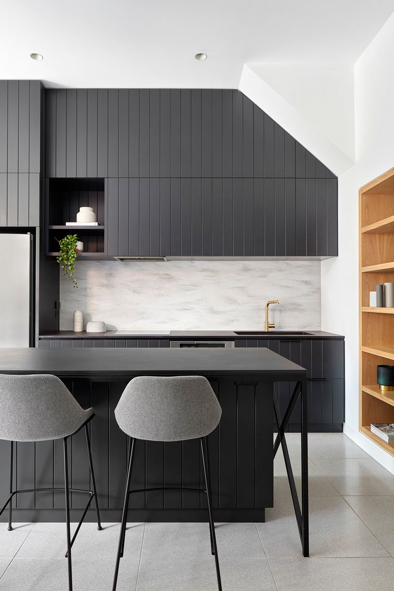 Architectural firm Bryant Alsop designed the modern renovation of an early-Victorian terrace and included a kitchen with matte black cabinets.