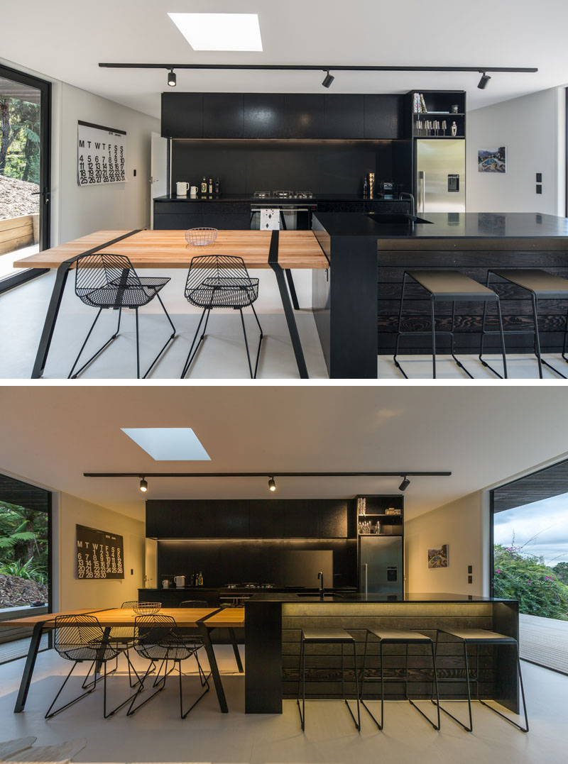 Evelyn McNamara Architecture designed a modern spec house in New Zealand, with a dramatic black kitchen.