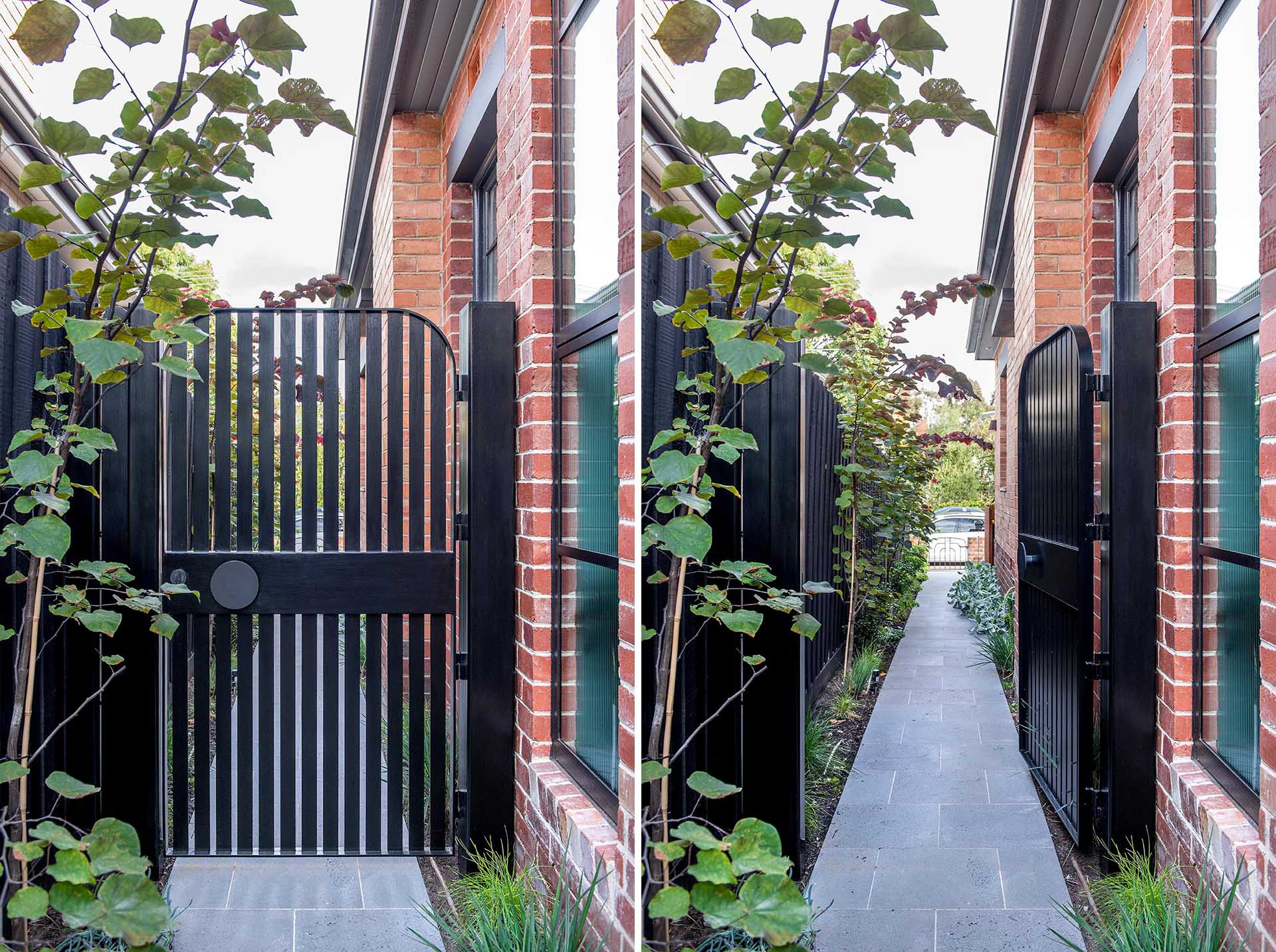A curved black side gate with a matching round handle.