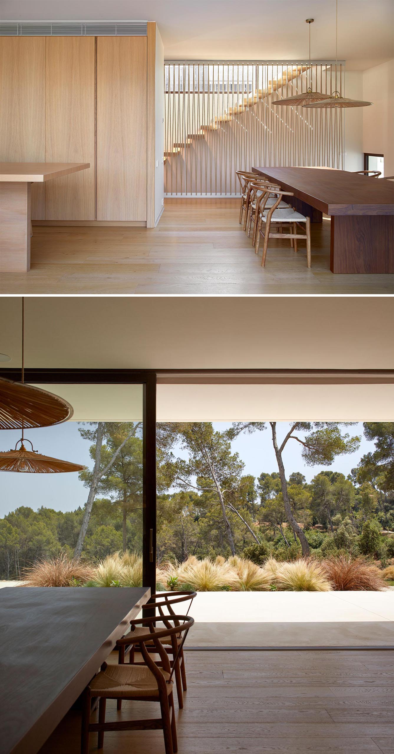 A modern home with a wood and off-white interior opens to a patio via a sliding door.