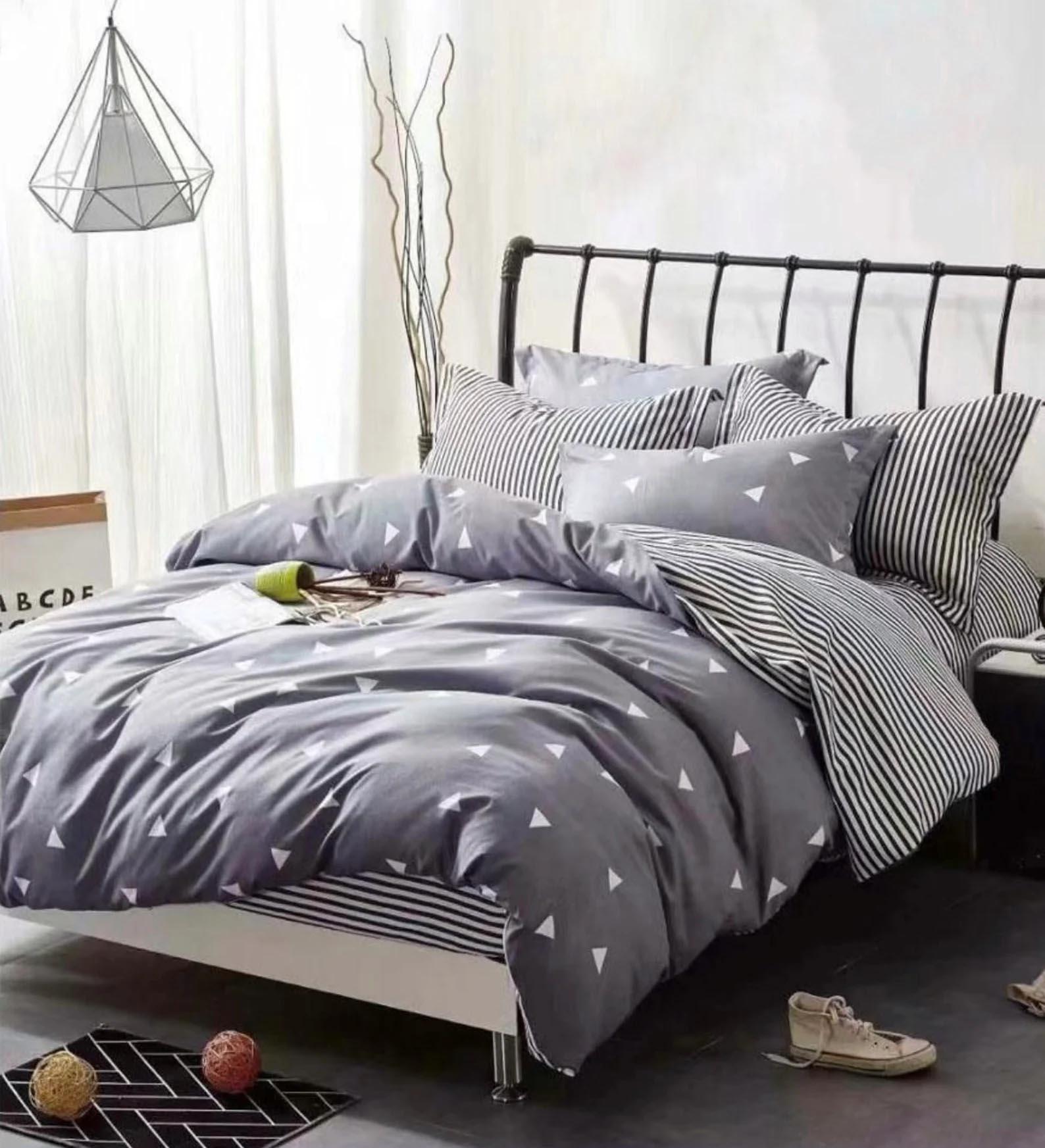 Modern Bedroom Decor - Geometric gray and white bedding.