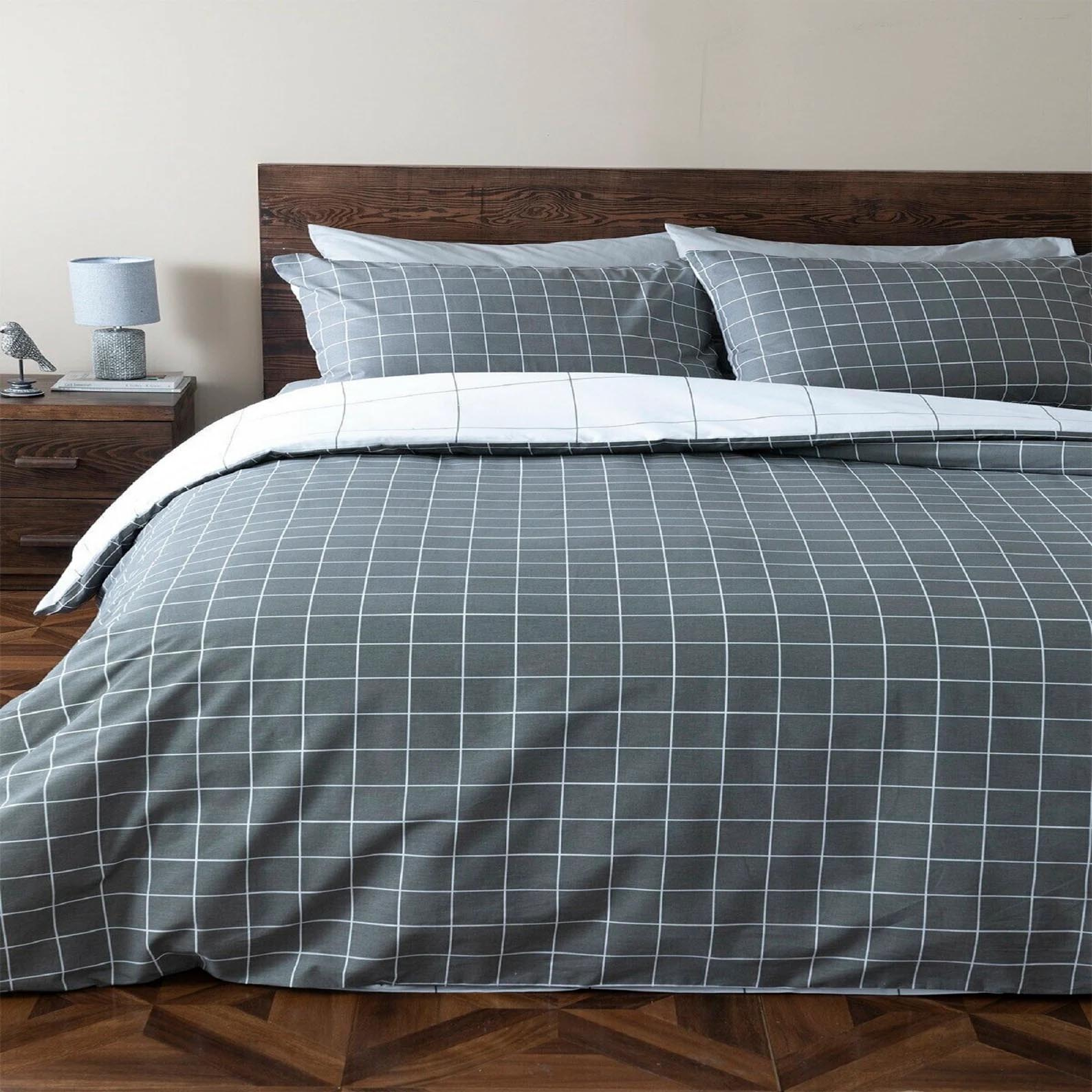 Modern Bedroom Decor - Grey and white geometric bedding.